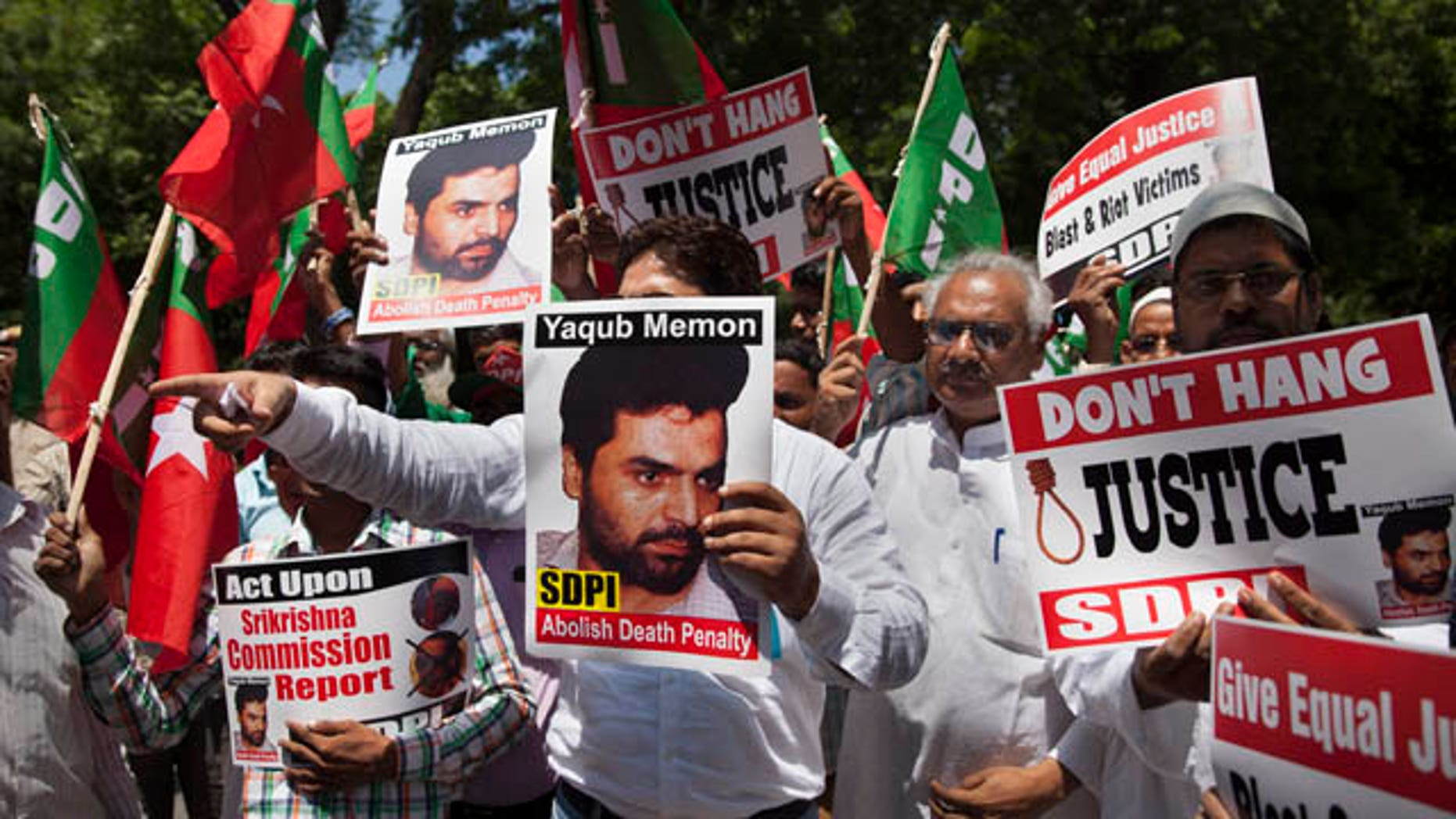July 27, 2015: Activists of the Social Democratic Party of India carry placards with portraits of Yakub Abdul Razak Memon, convicted in the 1993 Mumbai bombings, during a protest against his death sentence outside Maharashtra House in New Delhi. (AP Photo/Tsering Topgyal)