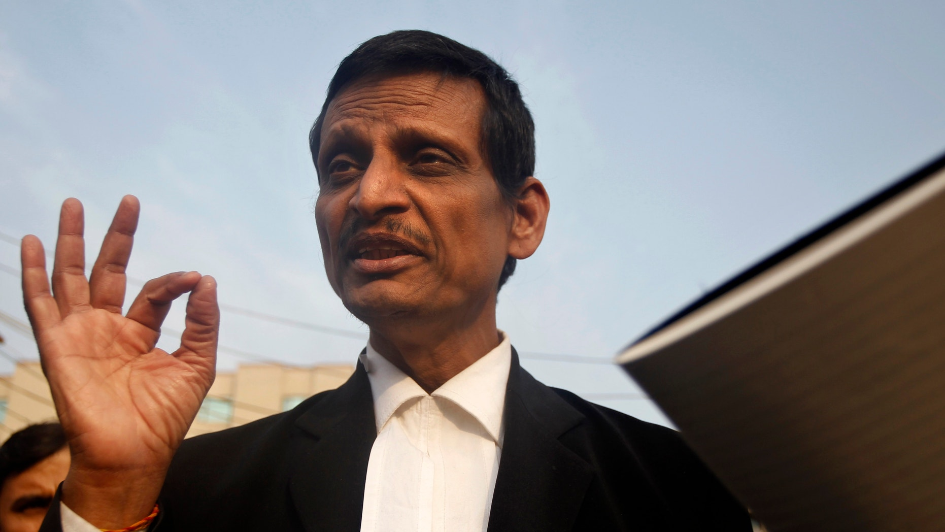 Jan. 14, 2013 - Lal Sharma, lawyer for one of the accused, speaks to journalists outside Saket district court where the accused in a gang rape are to be tried, in New Delhi, India.