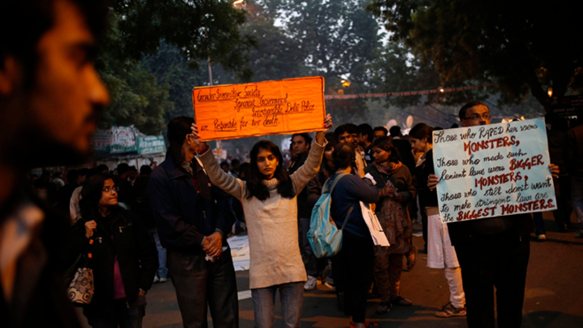 Dec. 29, 2012: Indian women and men hold placards as they mourn the death of a gang rape victim in New Delhi, India.
