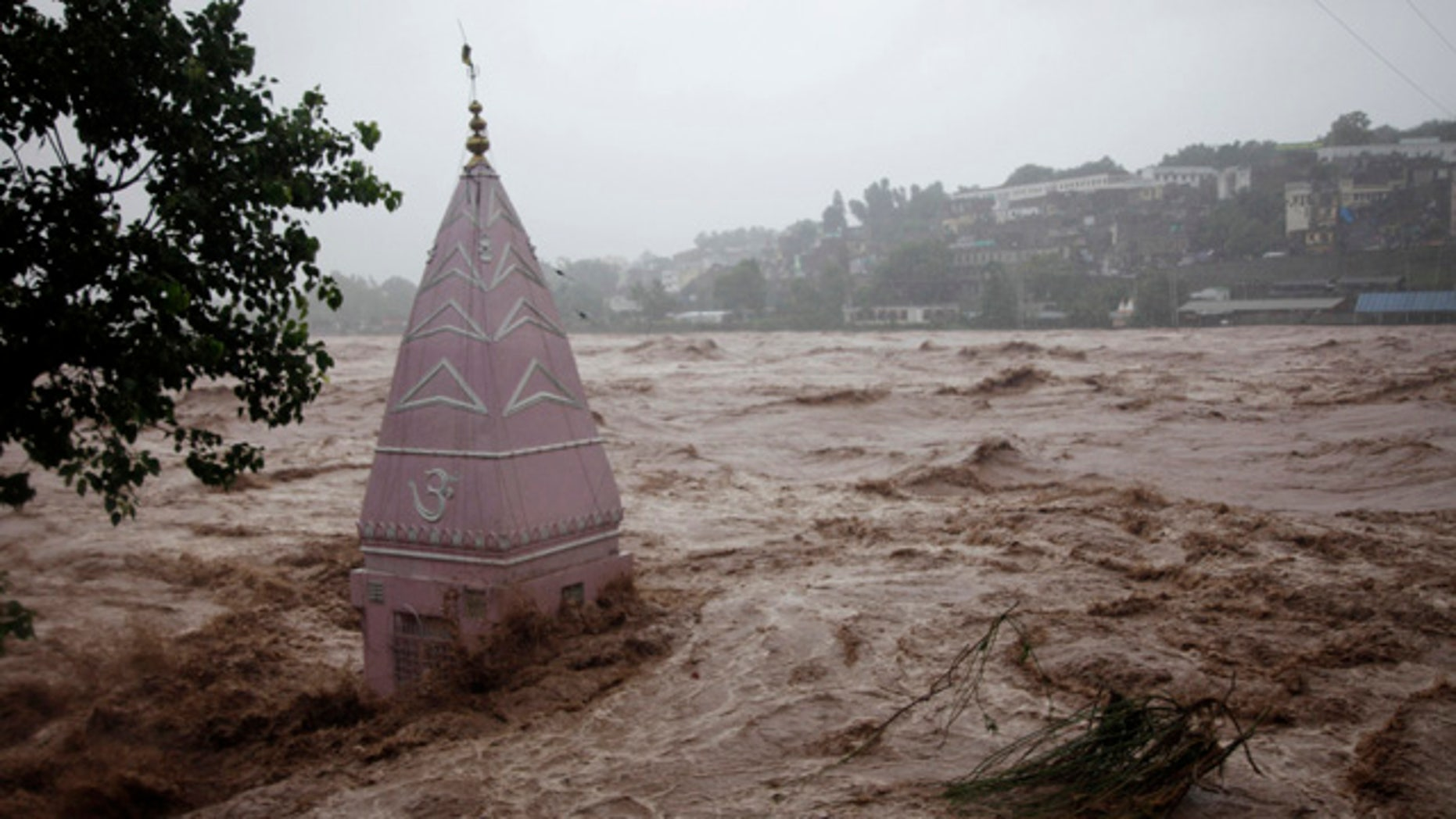 September 6, 2014: A temple is partially submerged in floodwaters in Jammu, India. (AP Photo/Channi Anand)