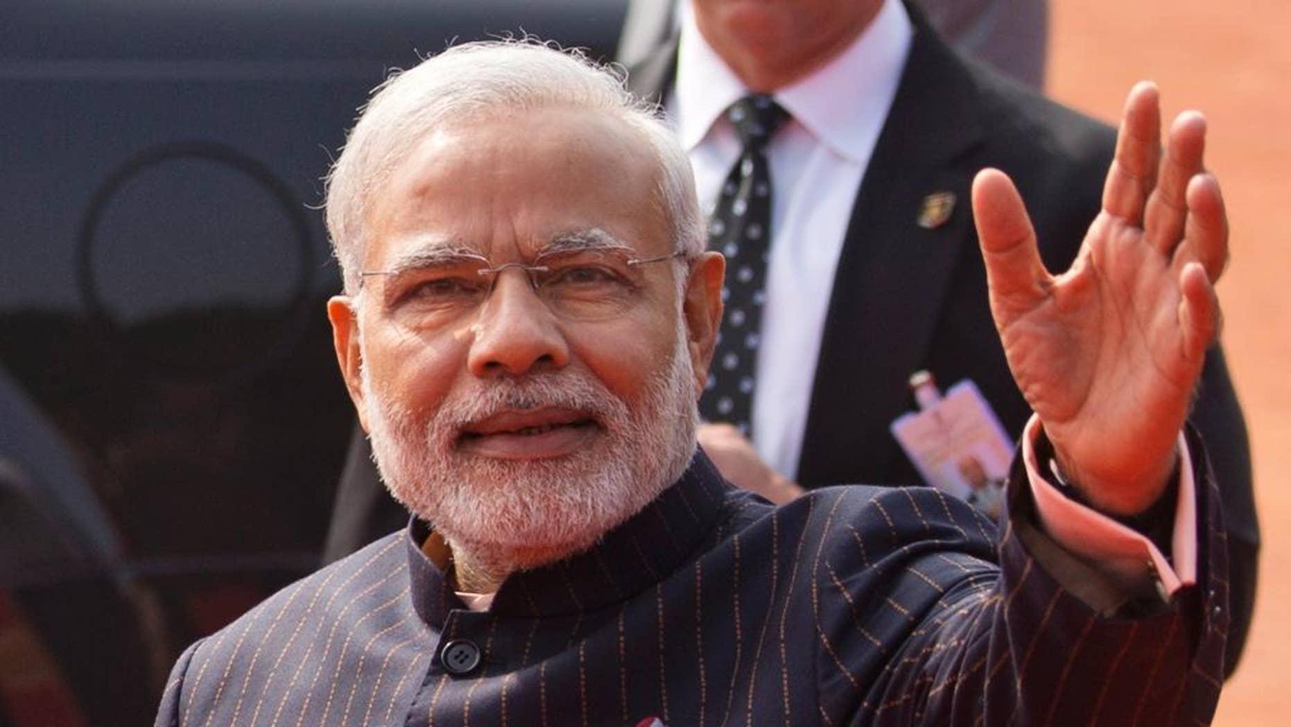Jan. 25, 2015: Indian Prime Minister Narendra Modi waves during a reception for President Obama in New Delhi.