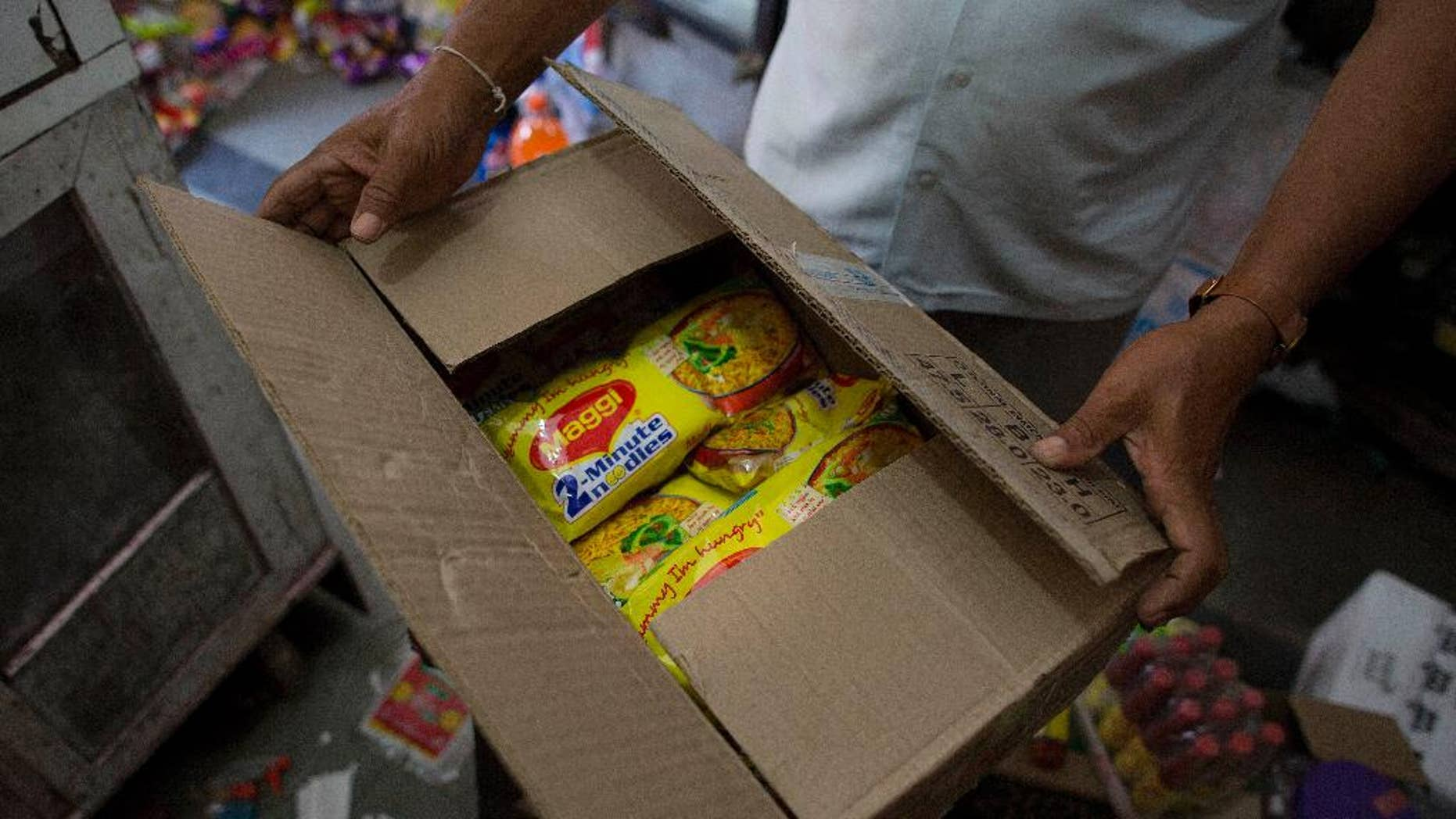 FILE-This June 5, 2015 file photo shows packs of Nestle India's Maggi noodles being stored after they were removed from the shelves of a grocery store in Gauhati, India. Maggi noodles are back on shelves in India five months after the popular snack was found to contain lead above permissible limits.(AP Photo/Anupam Nath, file)