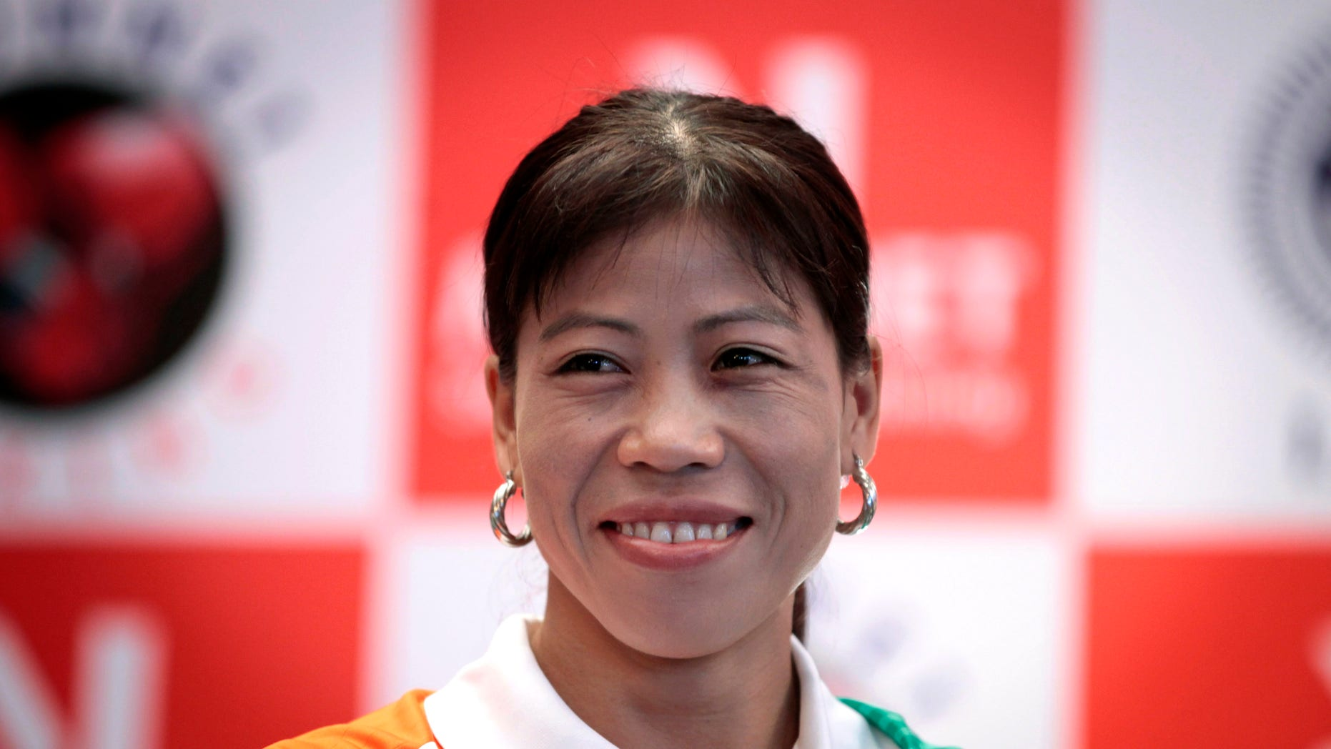 July 12, 2012: Indian woman boxer M.C. Mary Kom, who will compete in the upcoming Olympic Games, smiles during a press conference in New Delhi, India.