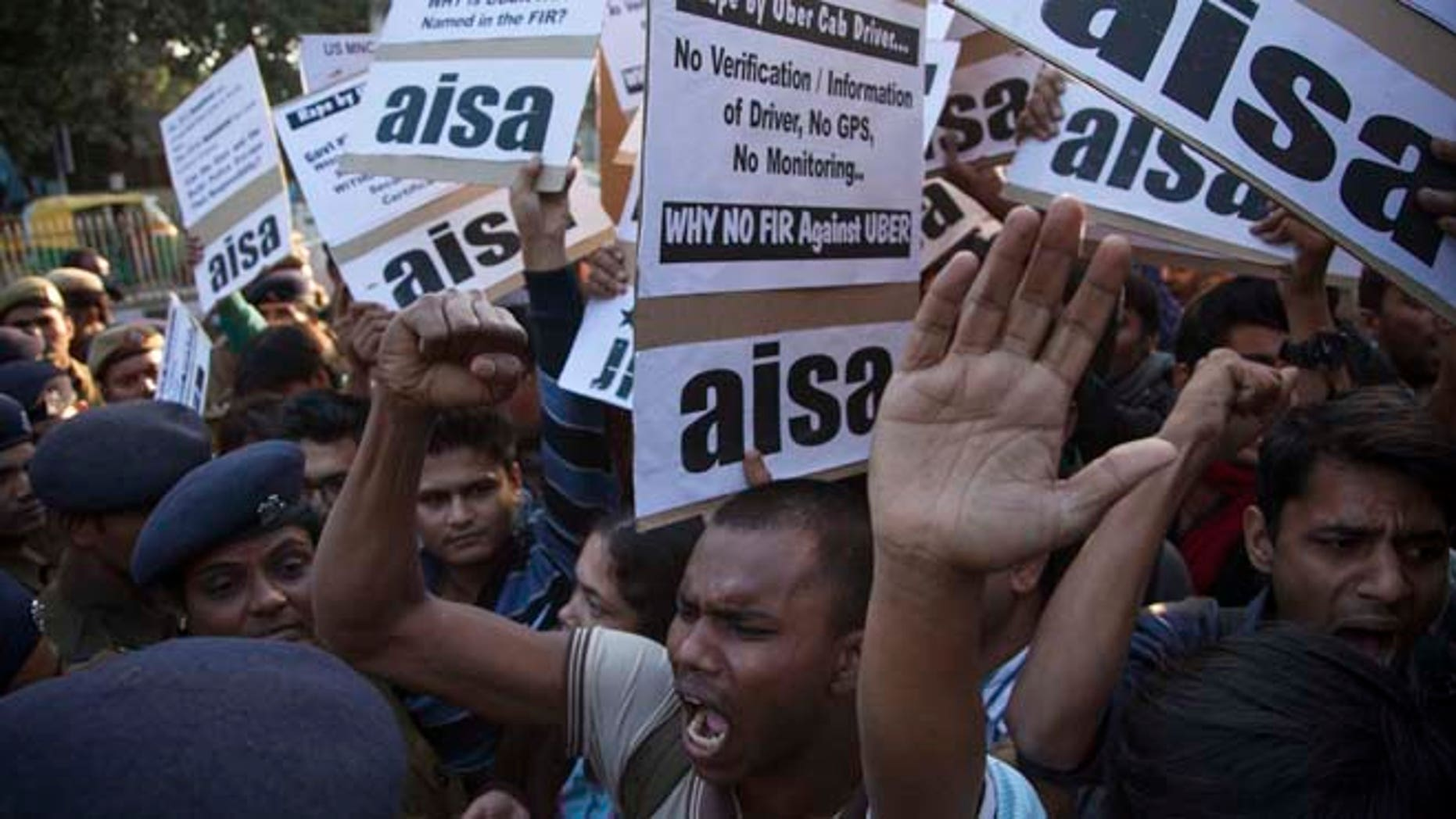 Dec. 7, 2014: Protestors from All India Students Association (AISA) demonstrate outside the Delhi Police headquarters after a taxi driver from the international cab-booking service Uber allegedly raped a young woman Friday in New Delhi, India. (AP)