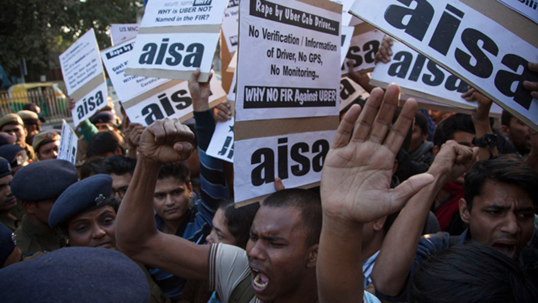 December 7, 2014: Protestors from All India Students Association (AISA) demonstrate outside the Delhi Police headquarters after a taxi driver from the international cab-booking service Uber allegedly raped a young woman Friday in New Delhi. (AP Photo/Tsering Topgyal)