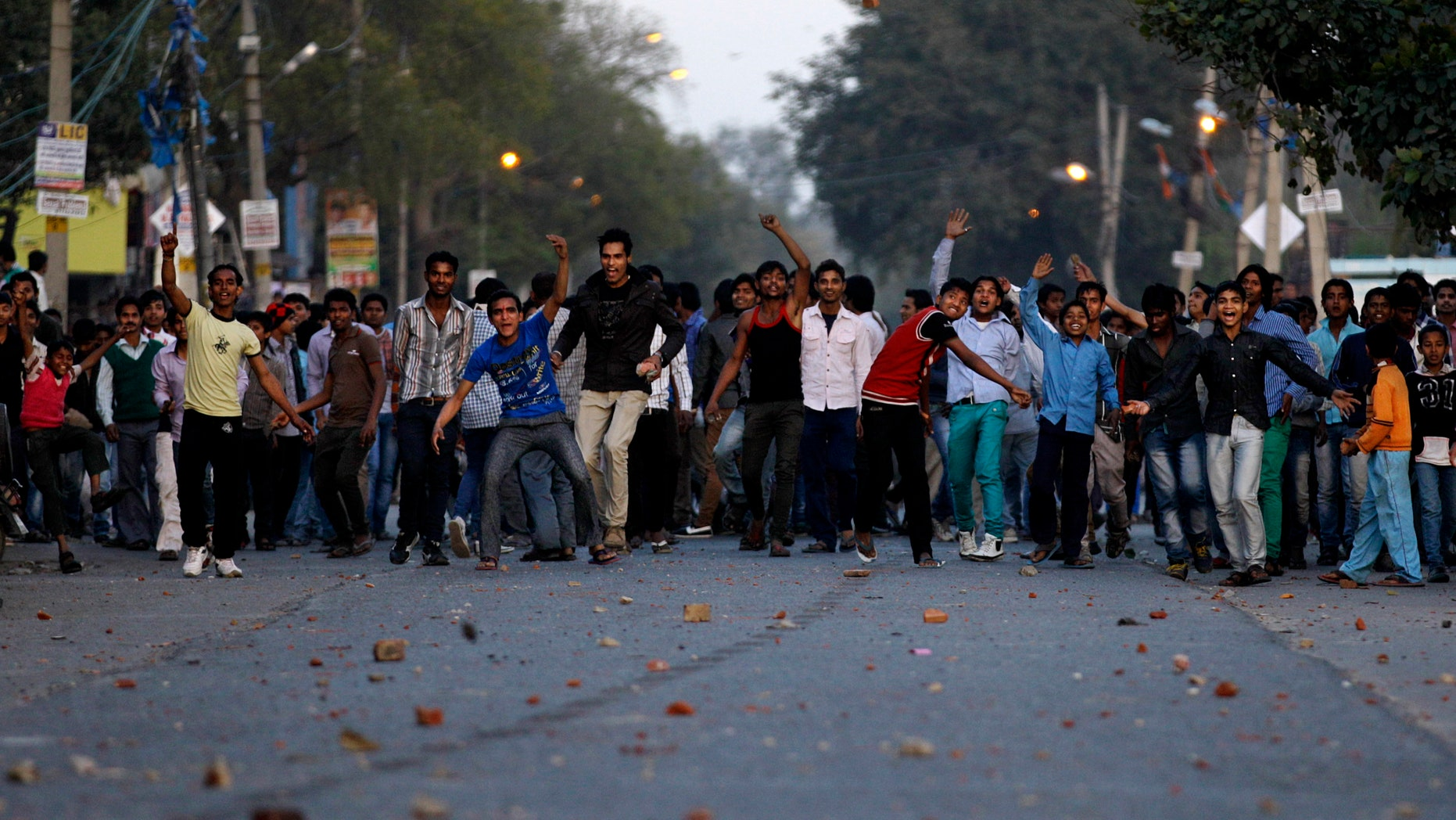 March 1, 2013 - Indian protesters hurl stones towards police officers during a protest against the rape of a 7-year-old girl in New Delhi, India.