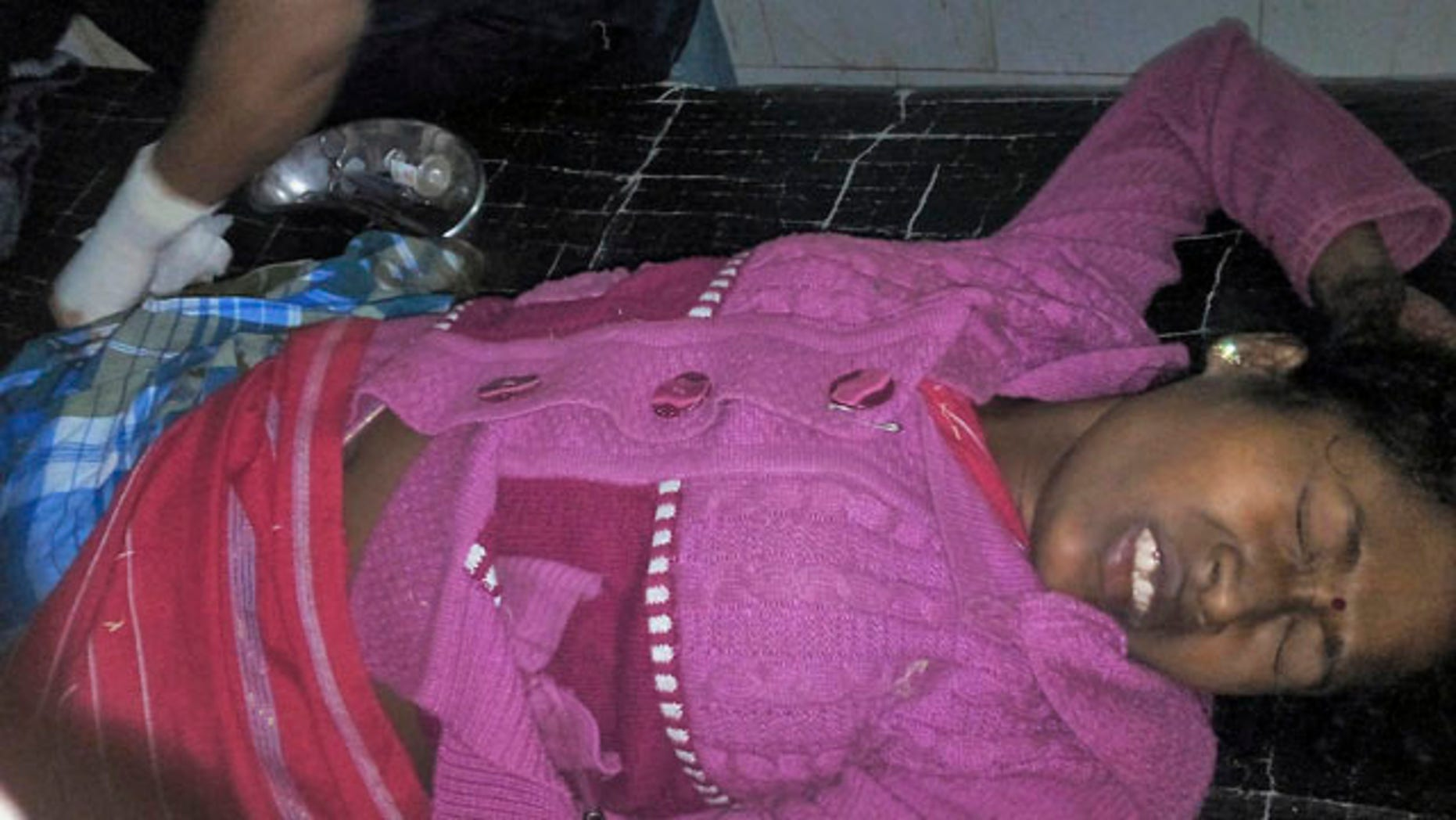 Dec. 23, 2014: An injured person is treated at a hospital in Kokrajhar district, in northeast state of Assam, India. (AP Photo/Press Trust of India)