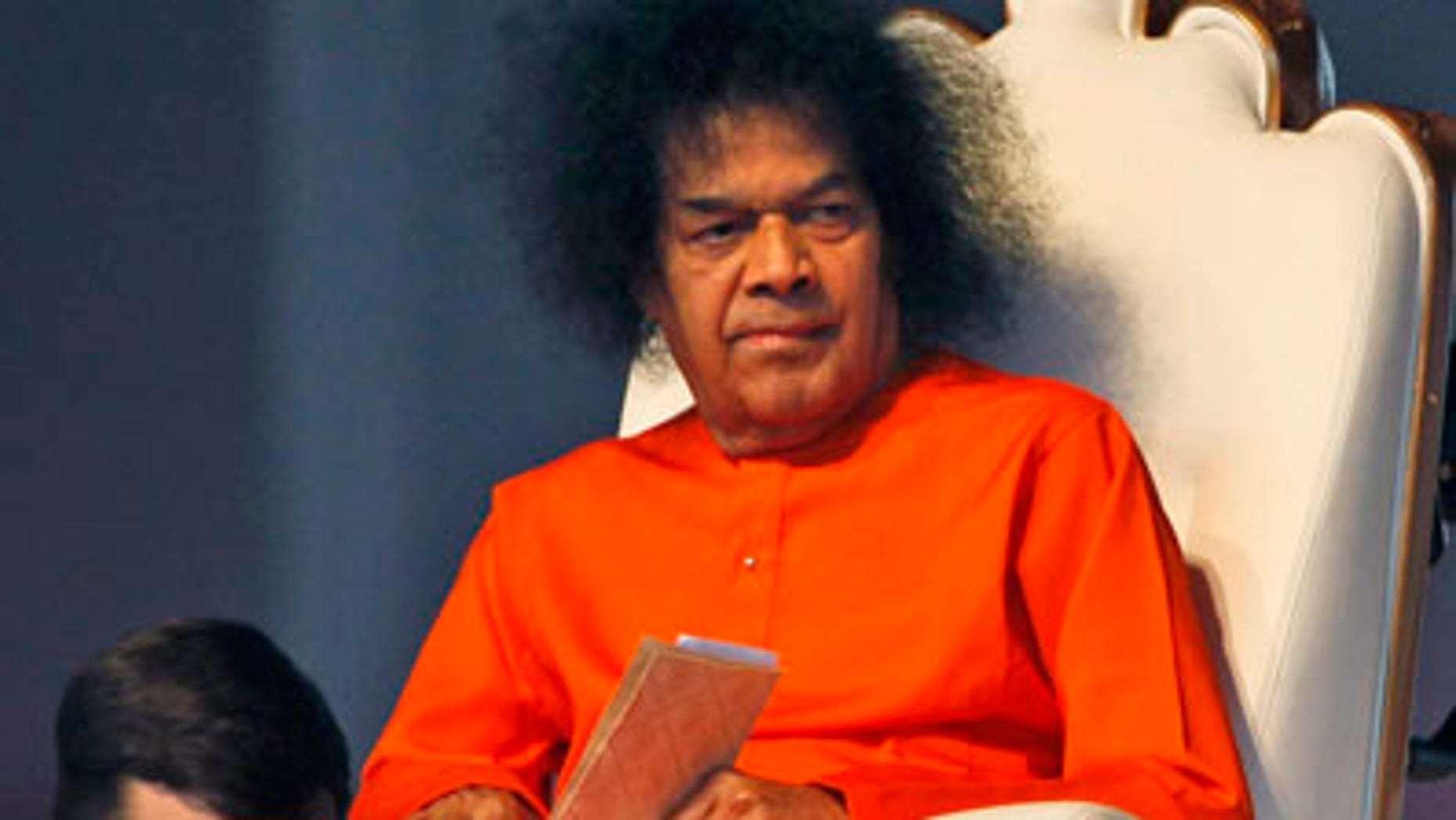 In this April 10, 2010 file photo, Indian spiritual leader Sathya Sai Baba looks on at a function to meet his devotees in New Delhi.  Dr. A.N. Safaya says Sathya Sai Baba died Sunday morning, after more than a week on breathing support and dialysis at the Sri Sathya Sai Institute of Higher Medical Sciences. (AP/File)