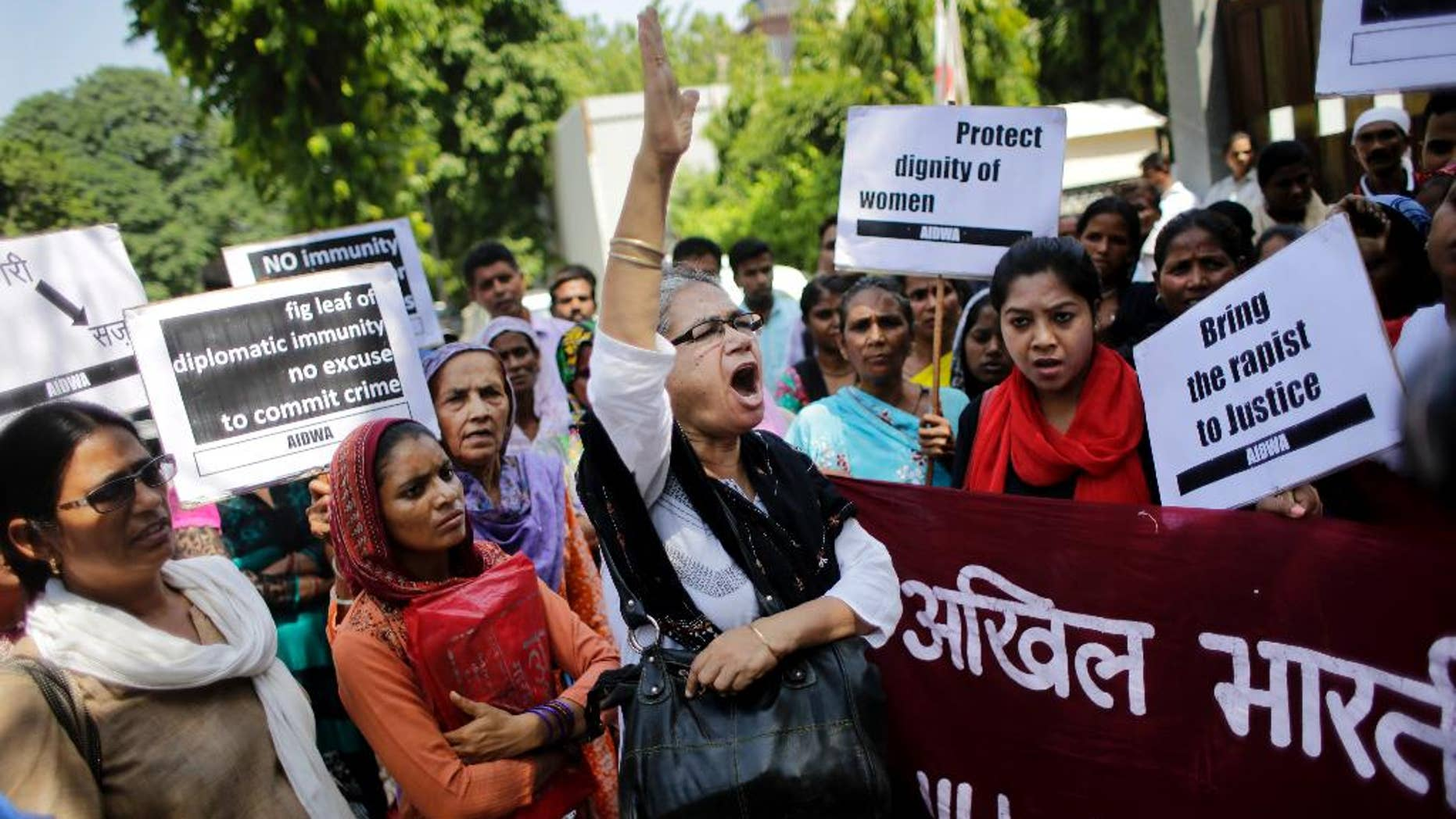 FILE - In this Thursday, Sept. 10, 2015 file photo, activists of All India Democratic Women's Association shout slogans during a protest outside the Saudi Arabian embassy in New Delhi, India. Indian officials say a Saudi Arabian diplomat accused of repeatedly raping and abusing two women has left India under the cover of diplomatic immunity. (AP Photo/Altaf Qadri, File)