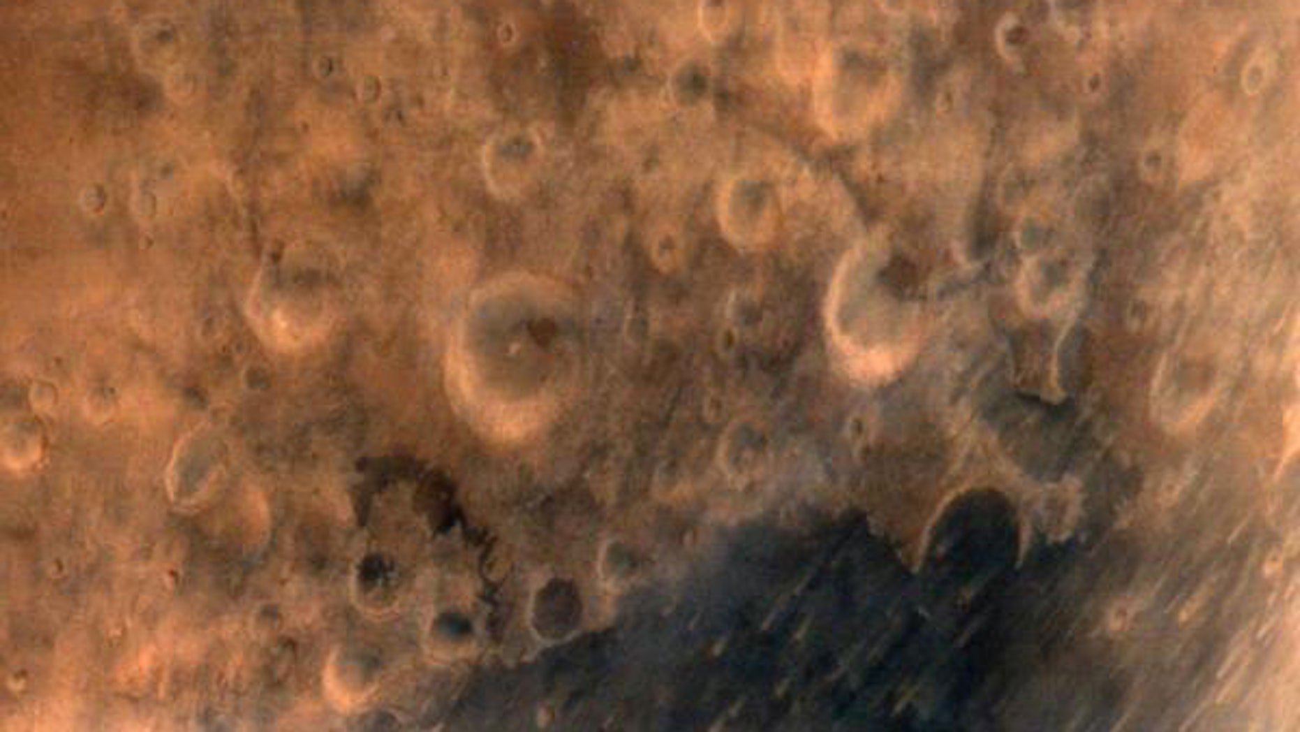 This image provided by the Indian Government Press Information Bureau shows what the agency says is one of the first images of the surface of Mars taken by India's Mars Orbiter Mission satellite, on Thursday, Sept. 25, 2014.