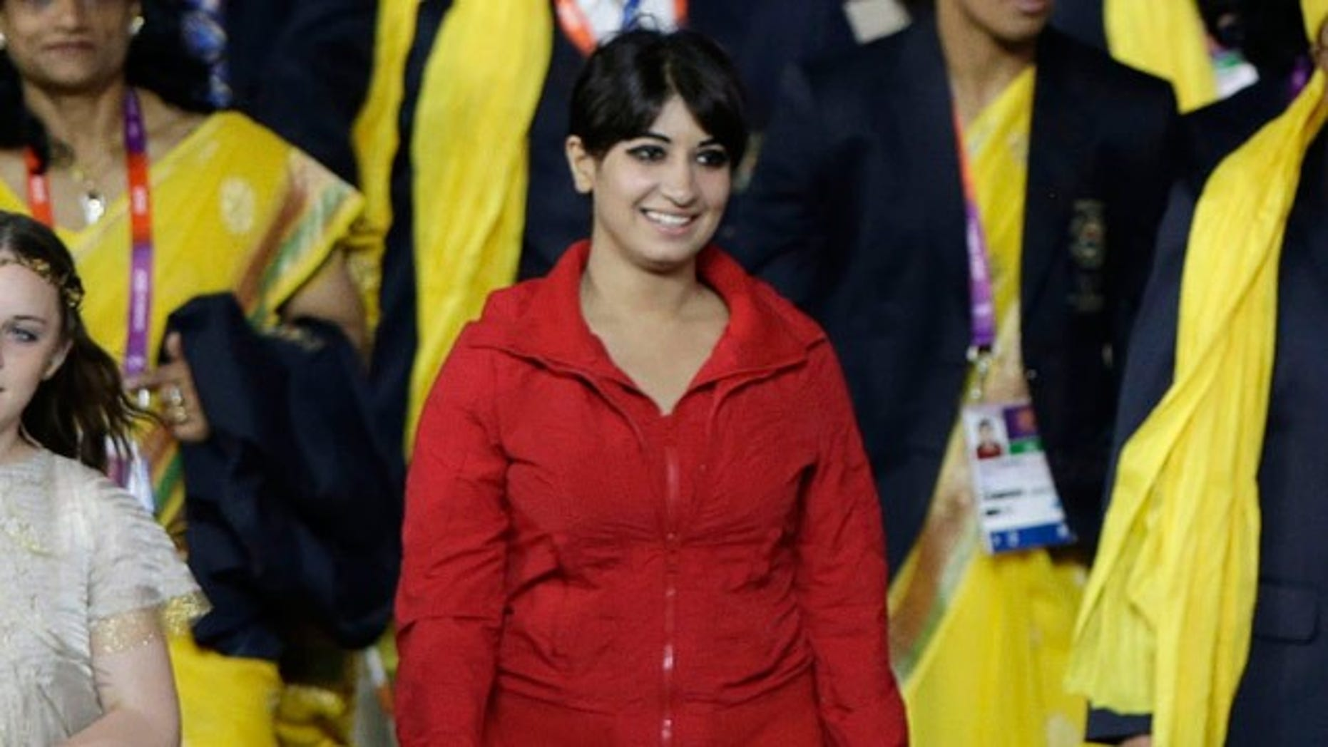 July 27, 2012: A cast member is shown walking with the Indian team during the Opening Ceremony at the 2012 Summer Olympics.