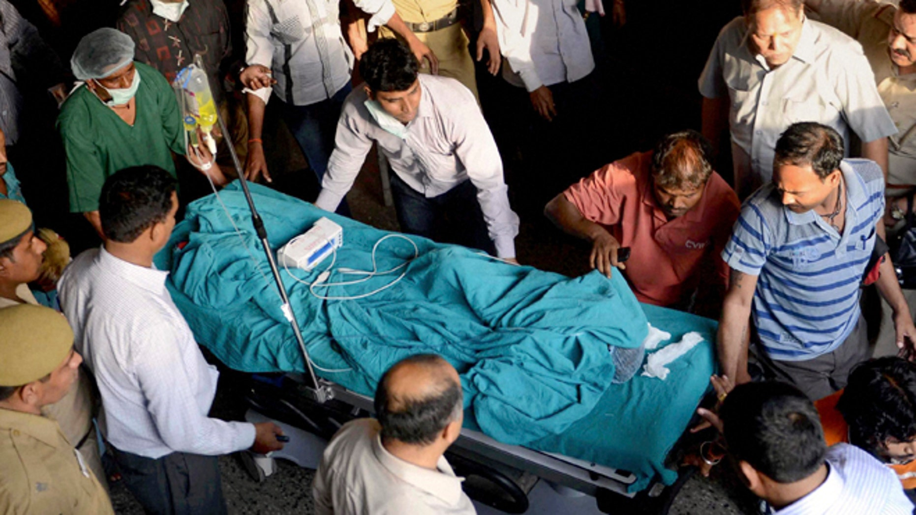 April 19: 5-year-old girl, according to police, is wheeled into a hospital for treatment after she was raped and tortured in New Delhi, India.