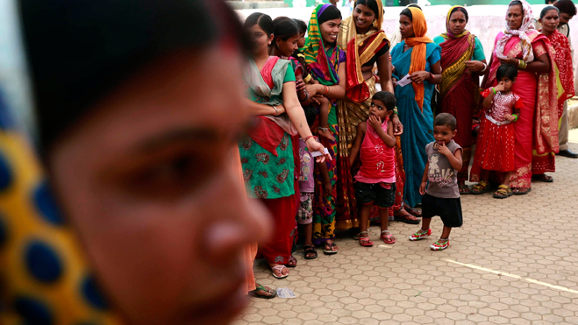April 17, 2014: Indian women stand in a queue to cast their votes in Rajnandgaon, in the central Indian state of Chhattisgarh, now the center of India's four-decade Maoist insurgency.