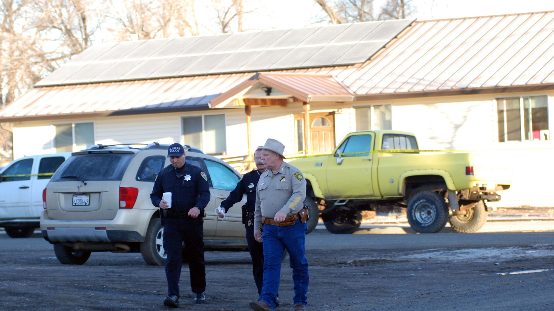 Feb. 21, 2014: Modoc County Sheriff and Coroner Mike Poindexter, right, walks away from the Cedarville Rancheria tribal headquarters building in Alturas, Calif.