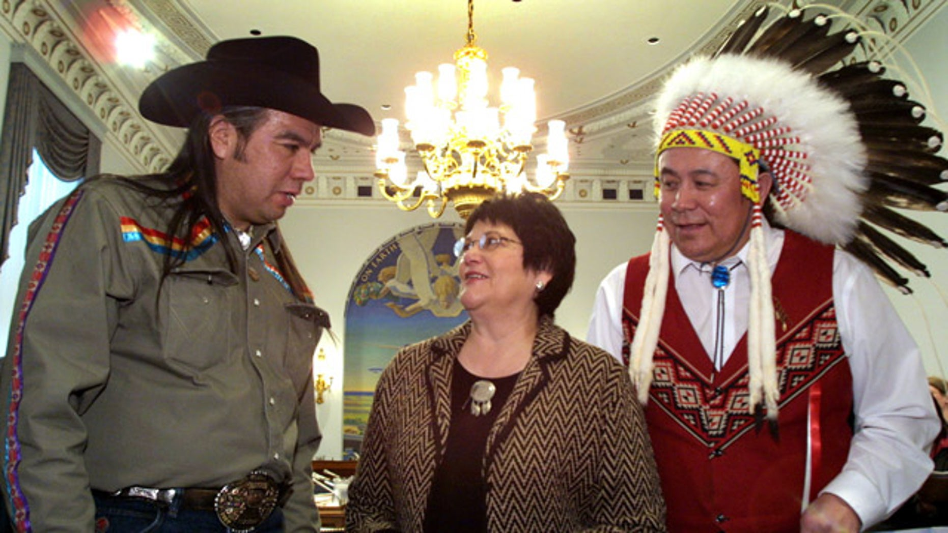 FILE - A Feb. 6, 2002 file photo shows National Congress of American Indians President Tex Hall, left, with Elouise Cobell of the Blackfeet Tribe of Montana, center, and Jimmy Goddard, from the same tribe, on Capitol Hill.  Settlement payments among hundreds of thousands of Native Americans whose land-trust royalties were mismanaged by the government for more than a century have been held up by more than 2,400 appeals by people who were ruled ineligible to participate in the settlement. (AP Photo/Terry Ashe, File)