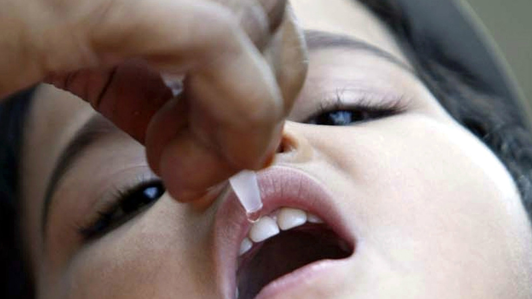 A child receives polio drops at a polio booth in the central Indian city of Bhopal.