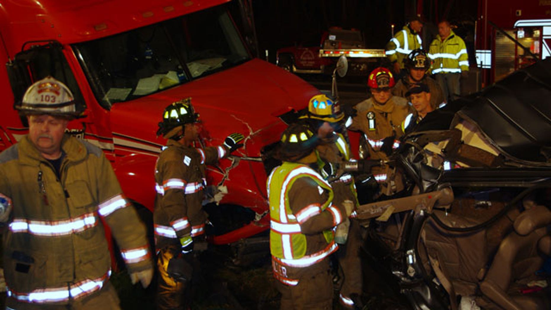 October 27, 2011: A photo released by the Indiana State Police shows firemen surveying the wreckage of a fatal accident on the Indiana Toll Road near Bristol, Ind.