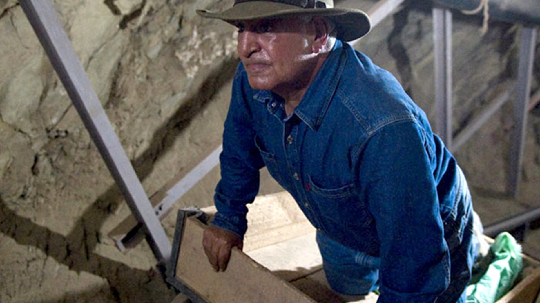 June 30, 2010: Looking for all the world like Indiana Jones, antiquities chief Zahi Hawass studies an unfinished 570-foot long tunnel in Luxor, Egypt -- first discovered in 1960 and possibly meant to be a secret tomb.