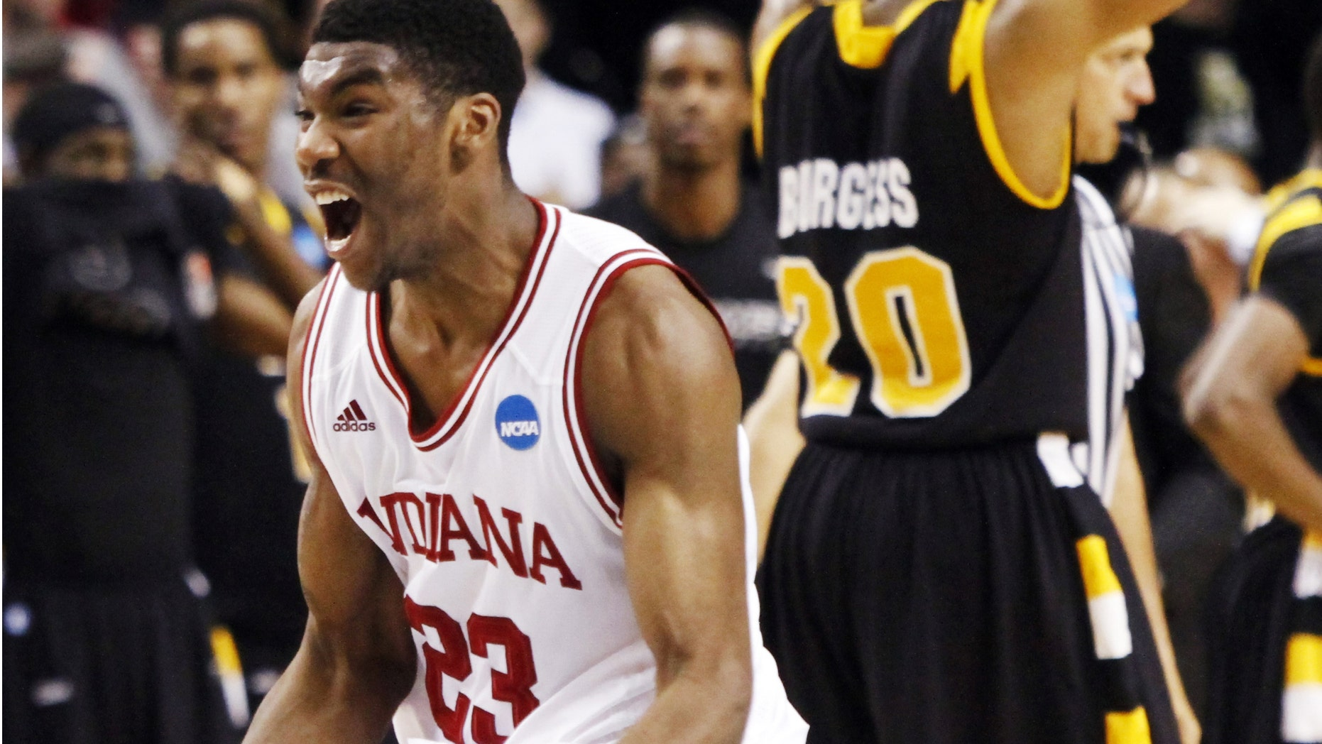 Indiana guard Remy Abell, left, celebrates as Virginia Commonwealth's Bradford Burgess walks away after Indiana's 63-61 win in an NCAA men's tournament third-round college basketball game in Portland, Ore., Saturday, March 17, 2012. (AP Photo/Don Ryan)