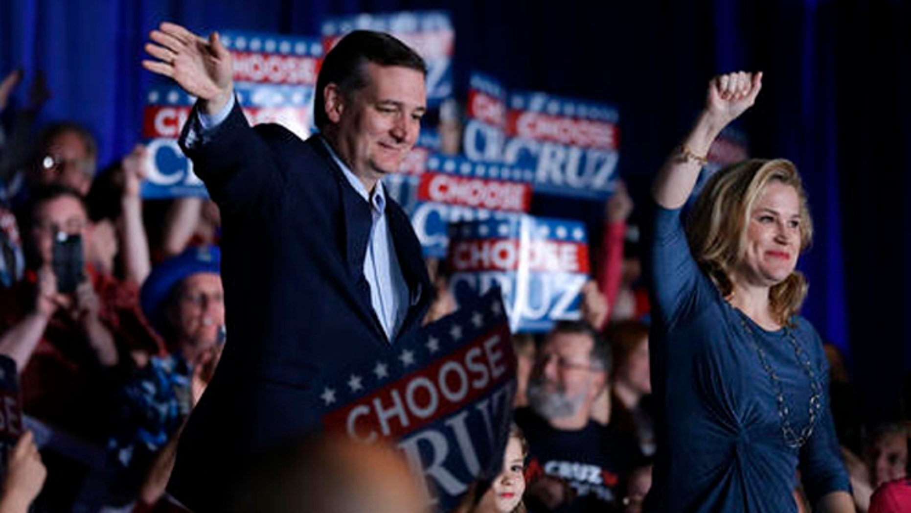 Republican presidential candidate Sen. Ted Cruz, R-Texas, waves with his wife Heidi at a rally at the Indiana State Fairgrounds in Indianapolis, Monday, May 2, 2016. (AP Photo/Michael Conroy)