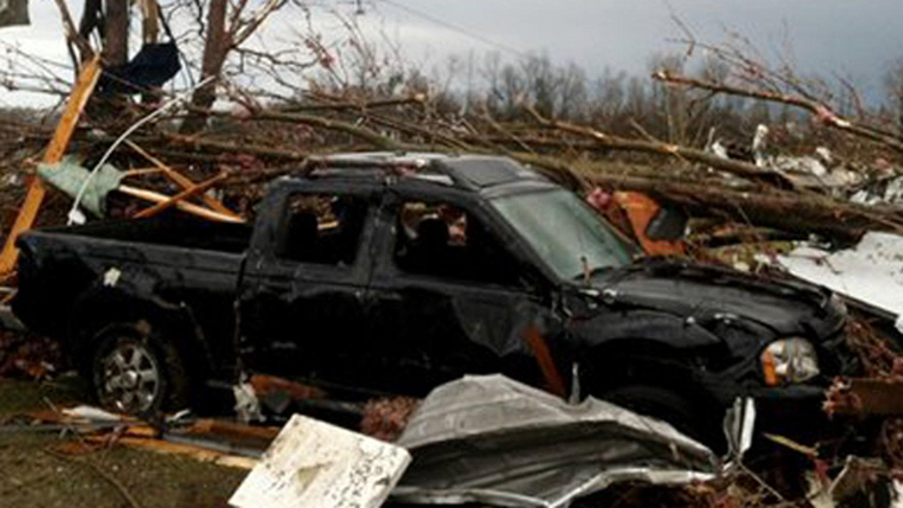 Mar. 3, 2012: A truck stands amongst storm damage near New Pekin, Ind.