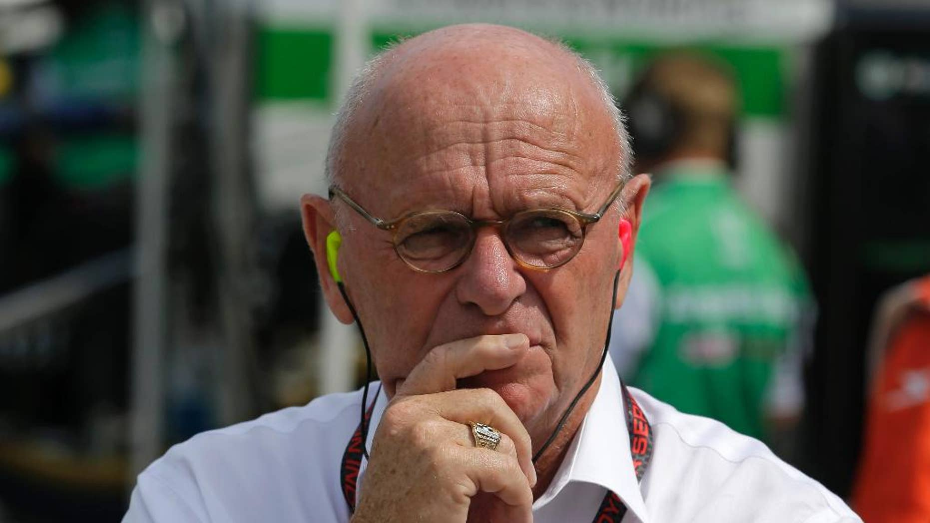 In this photo taken on Friday, May 8, 2015, Derrick Walker, President of operations and competition of IndyCar watches during practice for the Grand Prix of Indianapolis auto race at the Indianapolis Motor Speedway in Indianapolis. Derrick Walker might be one of the most liked officials in the IndyCar Series. He also has one of the toughest jobs. (AP Photo/Darron Cummings)