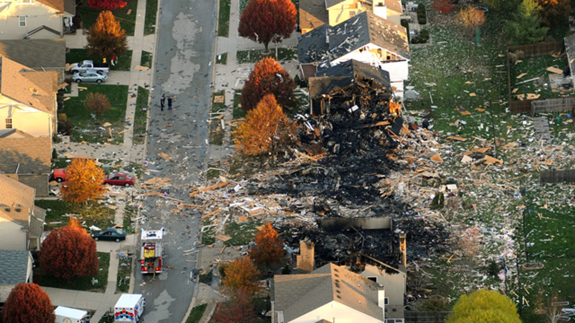 FILE - In this Nov. 11, 2012 file aerial photo are the two homes that were leveled and the neighboring homes that were damaged by a massive explosion in Indianapolis that sparked a huge fire and killed two people living in the neighborhood. On Tuesday, July 14, 2015, a jury convicted Mark Leonard of murder, arson and insurance fraud for his role in the explosion that devastated the subdivision. (AP Photo/The Indianapolis Star, Matt Kryger, File)