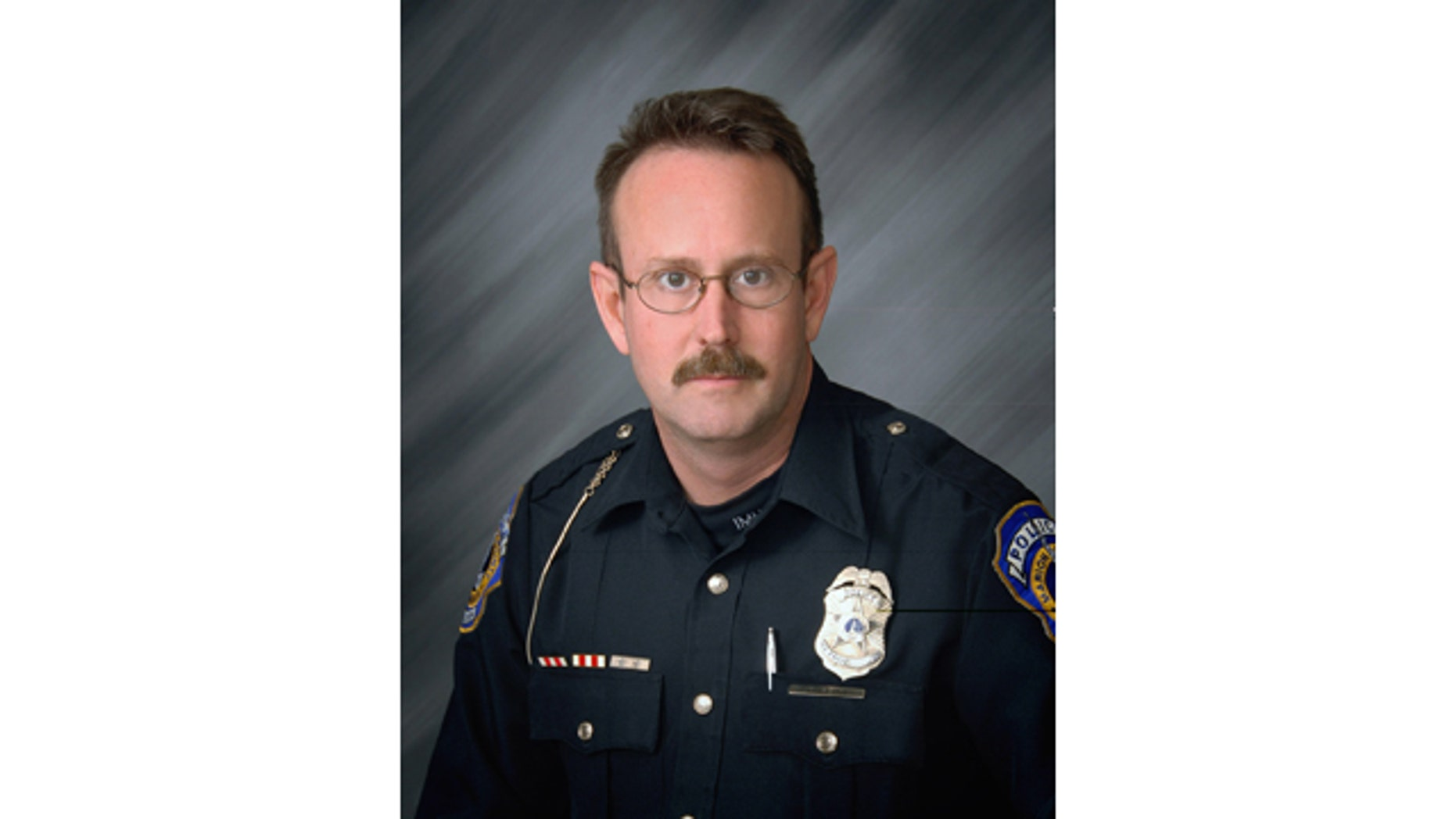 This undated photo released by the Indianapolis Metropolitan Police Department shows veteran officer Perry Renn, 51, who was shot and killed after he and another patrolman exchanged gunfire with a suspect in an alley Saturday night, July 5, 2014, in Indianapolis. (AP Photo/Indianapolis Metropolitan Police Dept.)