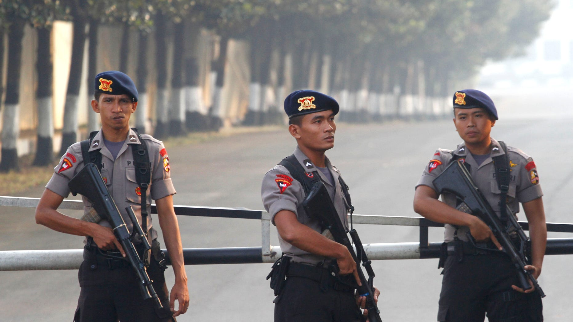 August 11: Armed officers man a checkpoint at the gate of a police compound where Indonesian militant, Umar Patek, is detained on the outskirts of Jakarta, Indonesia. Patek, who allegedly made the explosives used in the 2002 Bali bombings, returned to his homeland under tight security more than six months after he was captured in northwest Pakistan, officials said.