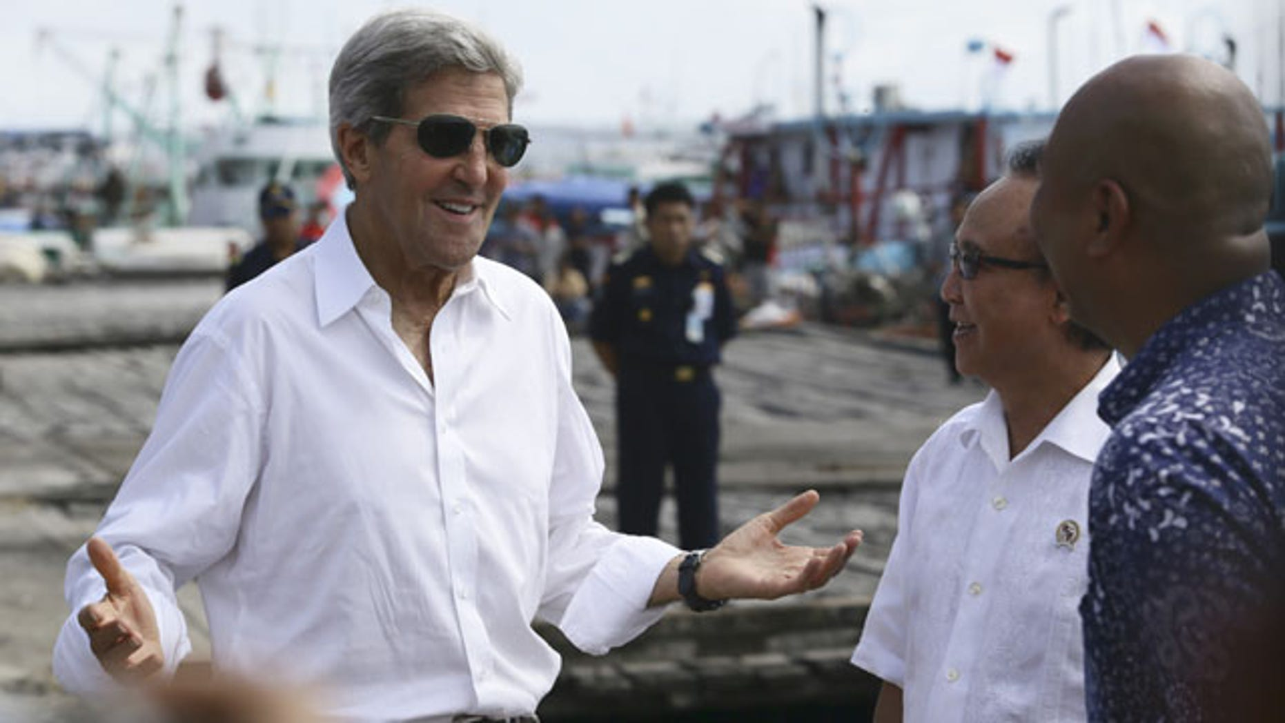 October 6, 2013: U.S. Secretary of State John Kerry speaks to officials during a visit to a tuna packaging factory in Bali, Indonesia. (AP Photo)