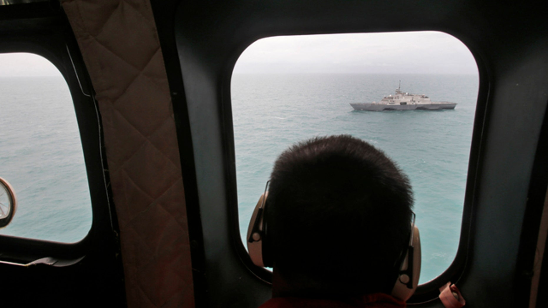 Jan. 6, 2015: A military ship is seen from Indonesian Air Force NAS 332 Super Puma helicopter during a search operation for the victims of AirAsia Flight 8501, off Pangkalan Bun, Central Borneo. (AP Photo/Achmad Ibrahim, Pool)