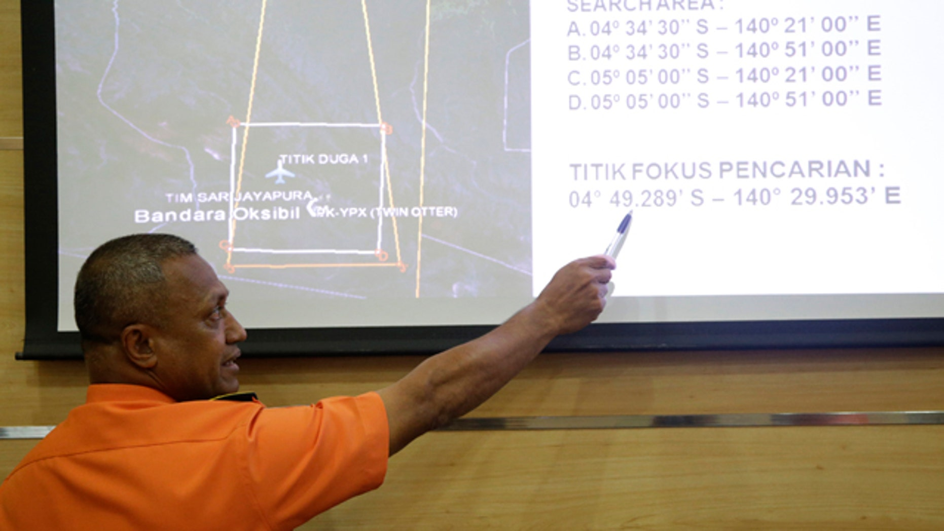 Aug. 17, 2015: National Search And Rescue Agency (BASARNAS) deputy operations director Heronimus Guru explains a search operation for the missing Trigana Air Service flight during a press conference in Jakarta, Indonesia. (AP Photo/Tatan Syuflana)