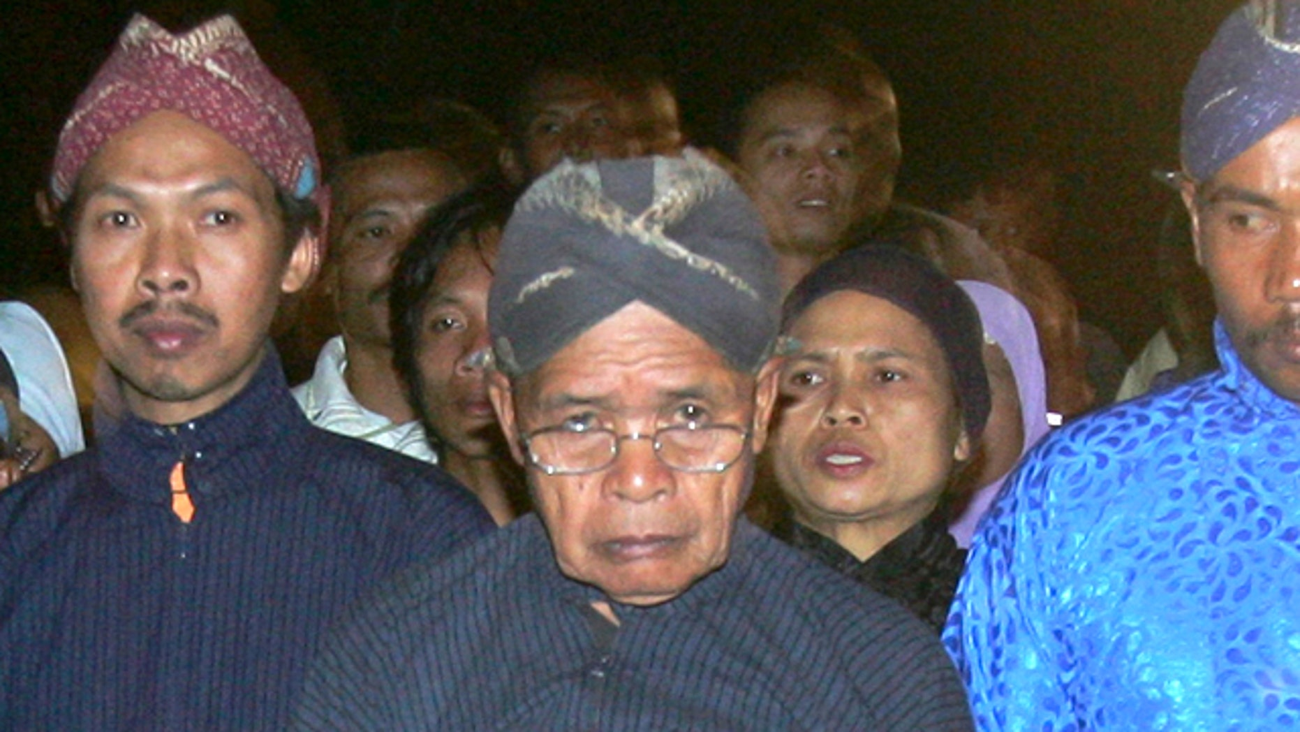 Maridjan (center), the spiritual guardian of Mount Merapi, performas a midnight walk in silence with other villagers in this 2006 photo. For 33 years, Maridjan spoke to Mount Merapi, appeasing its unpredictable spirits by offering of rice, clothes and chickens to the volcano that recently took his life.