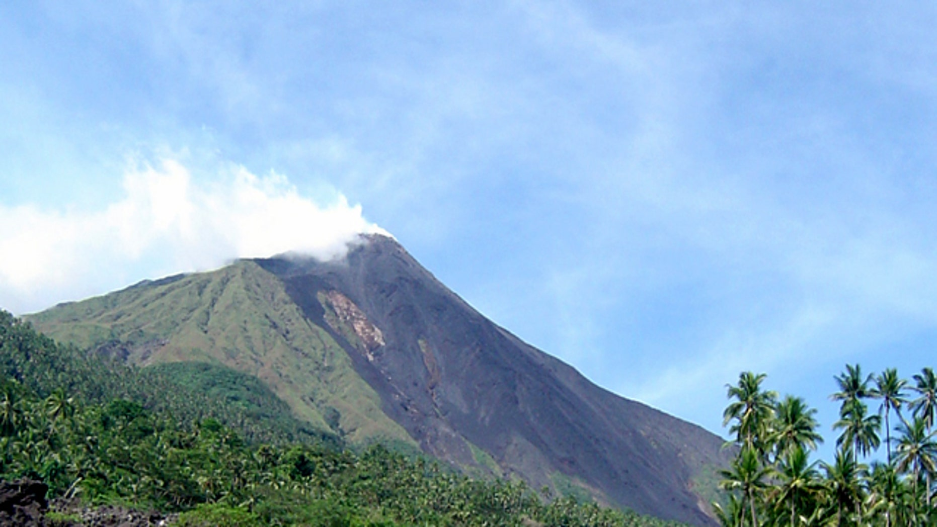 Debris from the Mount Karangetang volcano lies on the shoulder of the mountain in Siau, part of Indonesia's Sulawesi island chain, in this July 27, 2006 file photo.