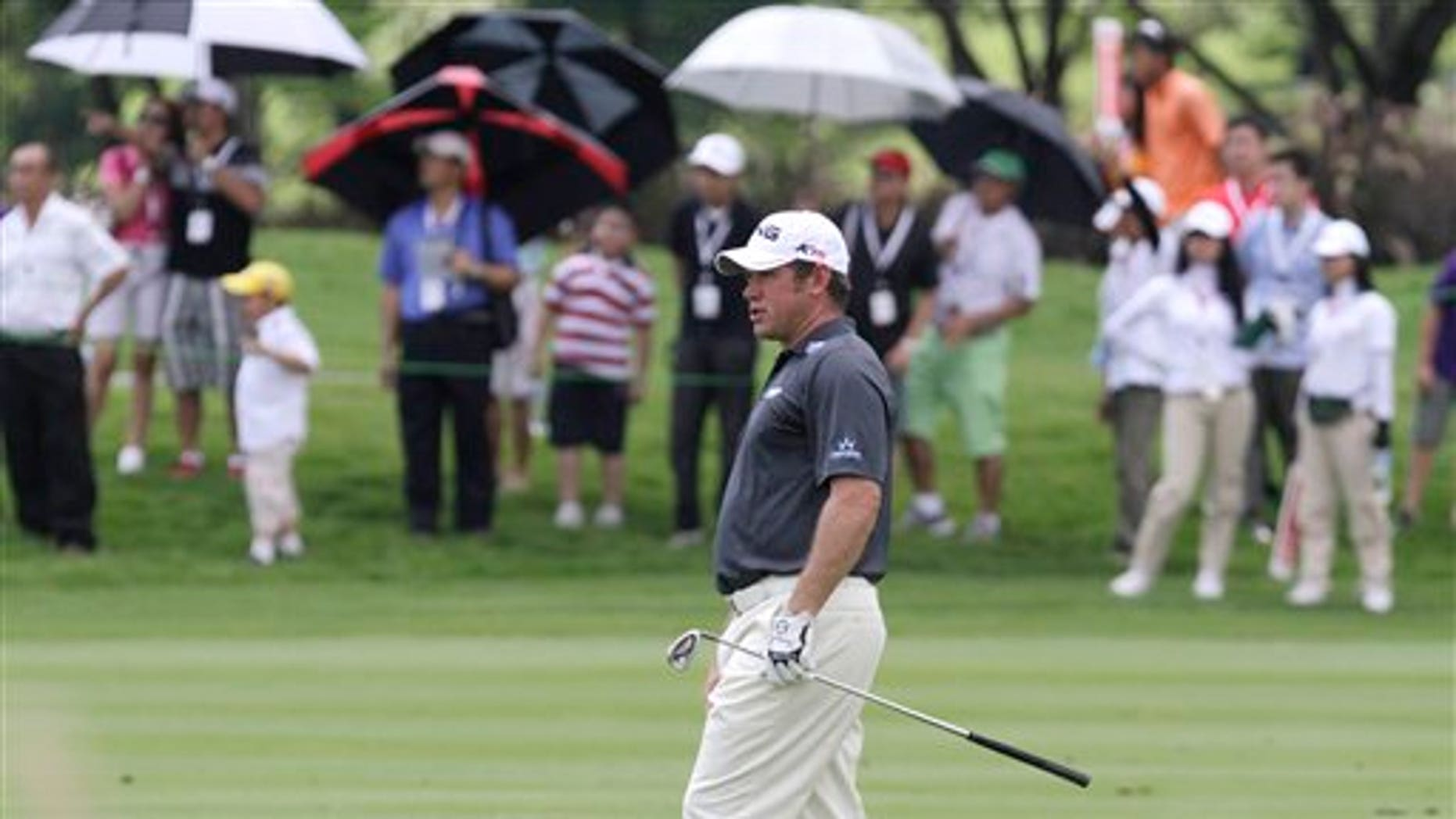 April 23, 2011: Lee Westwood of England watches his shot during the third round of the Indonesian Masters golf tournament at Royale Golf Club in Jakarta, Indonesia.