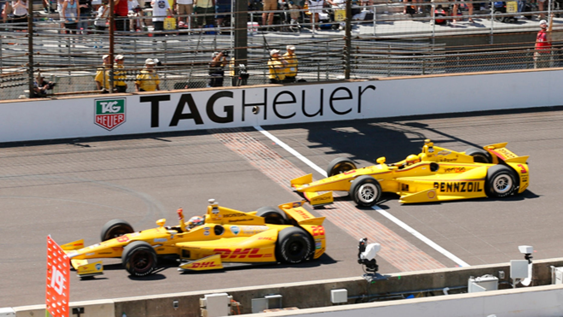 Ryan Hunter-Reay celebrates at the Indianapolis Motor Speedway in Indianapolis, Sunday, May 25, 2014.