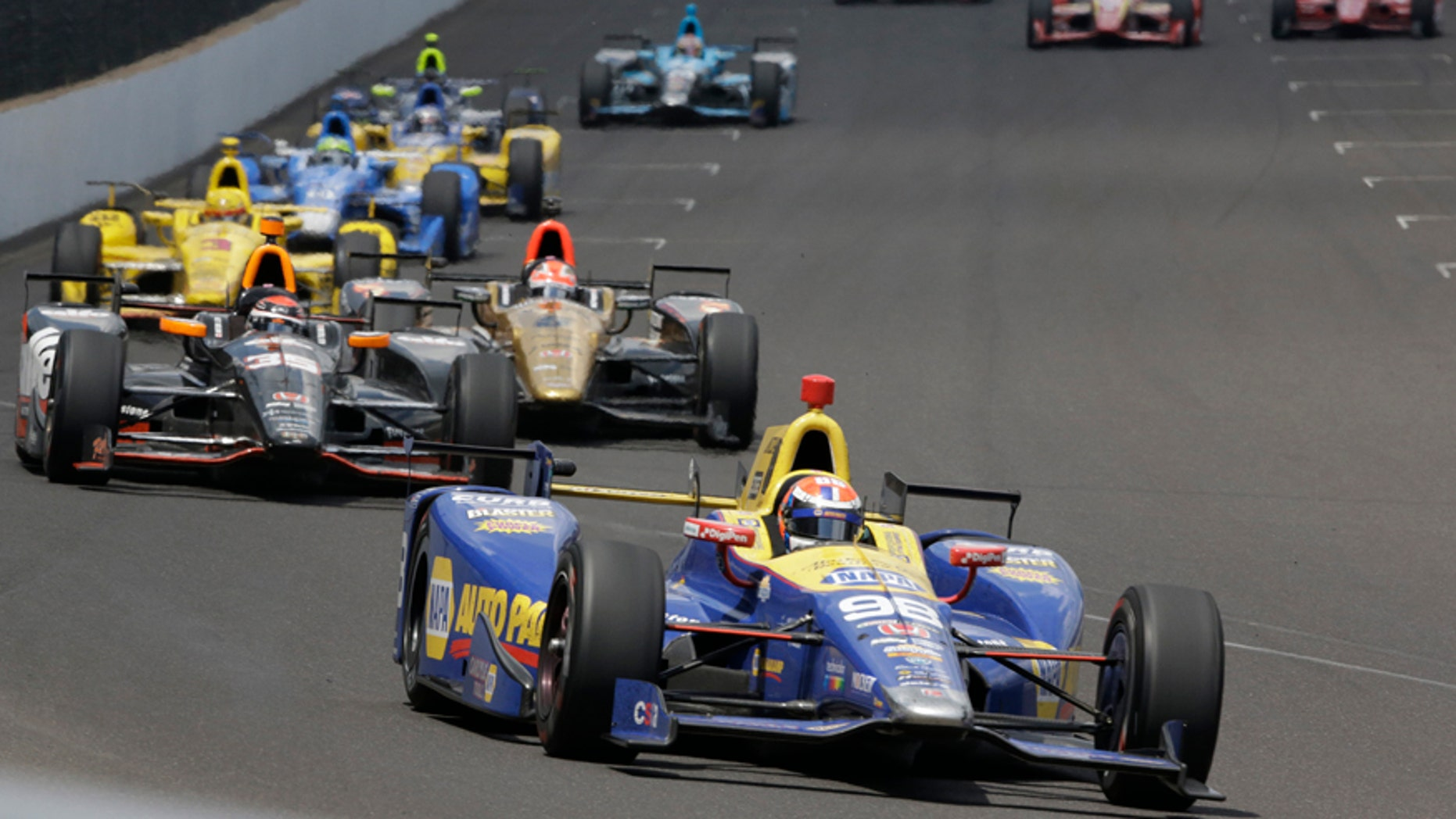 Alexander Rossi leads the field on his way to winning the 100th running of the Indianapolis 500 auto race at Indianapolis Motor Speedway in Indianapolis, Sunday, May 29, 2016. (AP Photo/R Brent Smith)