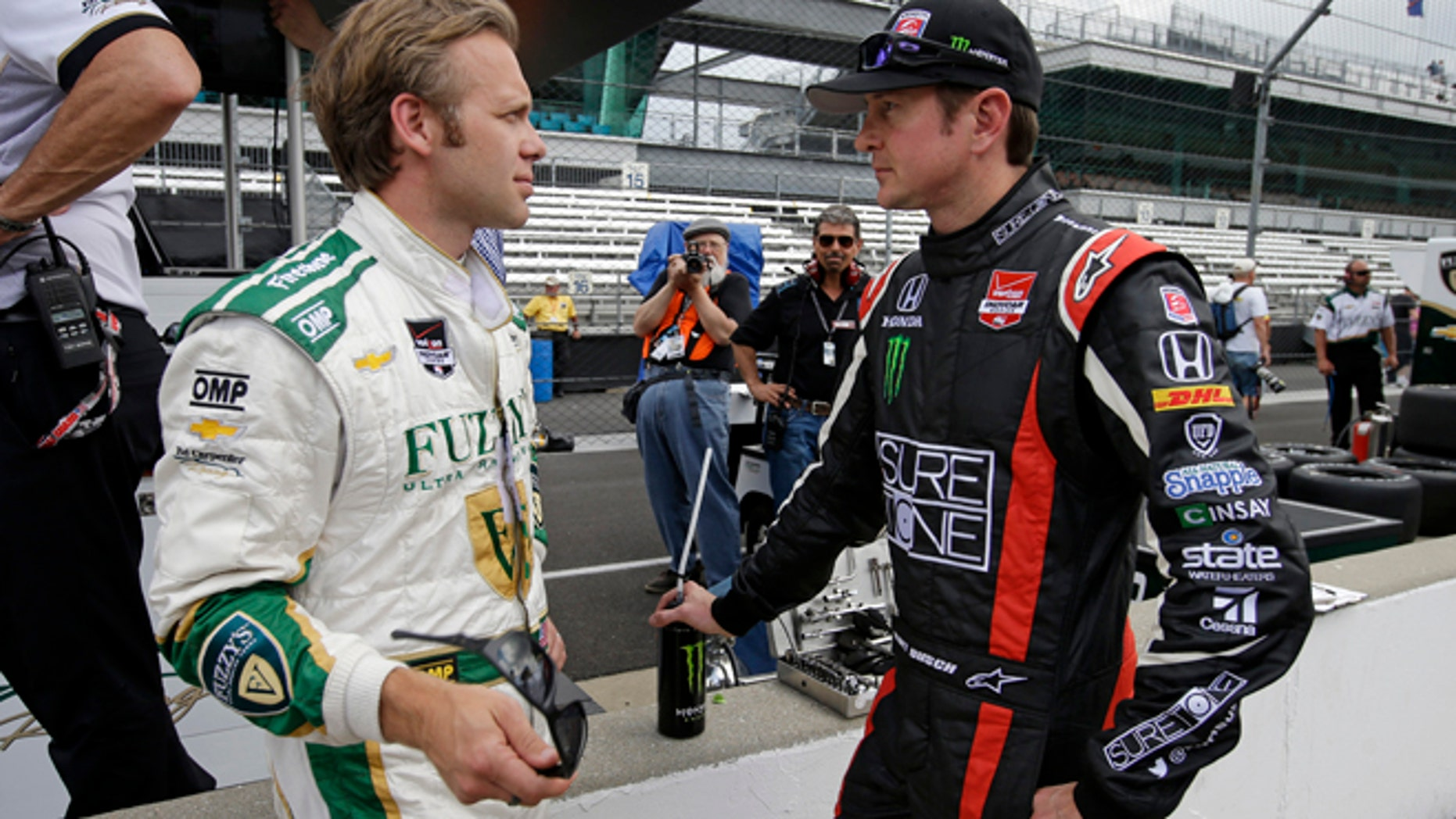 May 11, 2014:  Kurt Busch, right, talks with Ed Carpenter during practice for Indianapolis 500 IndyCar auto race at the Indianapolis Motor Speedway in Indianapolis. (AP)