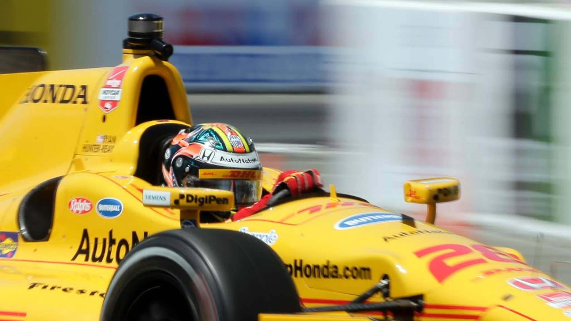 FILE - In this April 17, 2015, file photo, Ryan Hunter-Reay drives during a practice run for the IndyCar race at the Toyota Grand Prix of Long Beach in Long Beach, Calif. The two-time defending race champion returns to Alabama this weekend after a rough start that included a penalty from IndyCar with which he adamantly disagrees. (AP Photo/Chris Carlson, File)