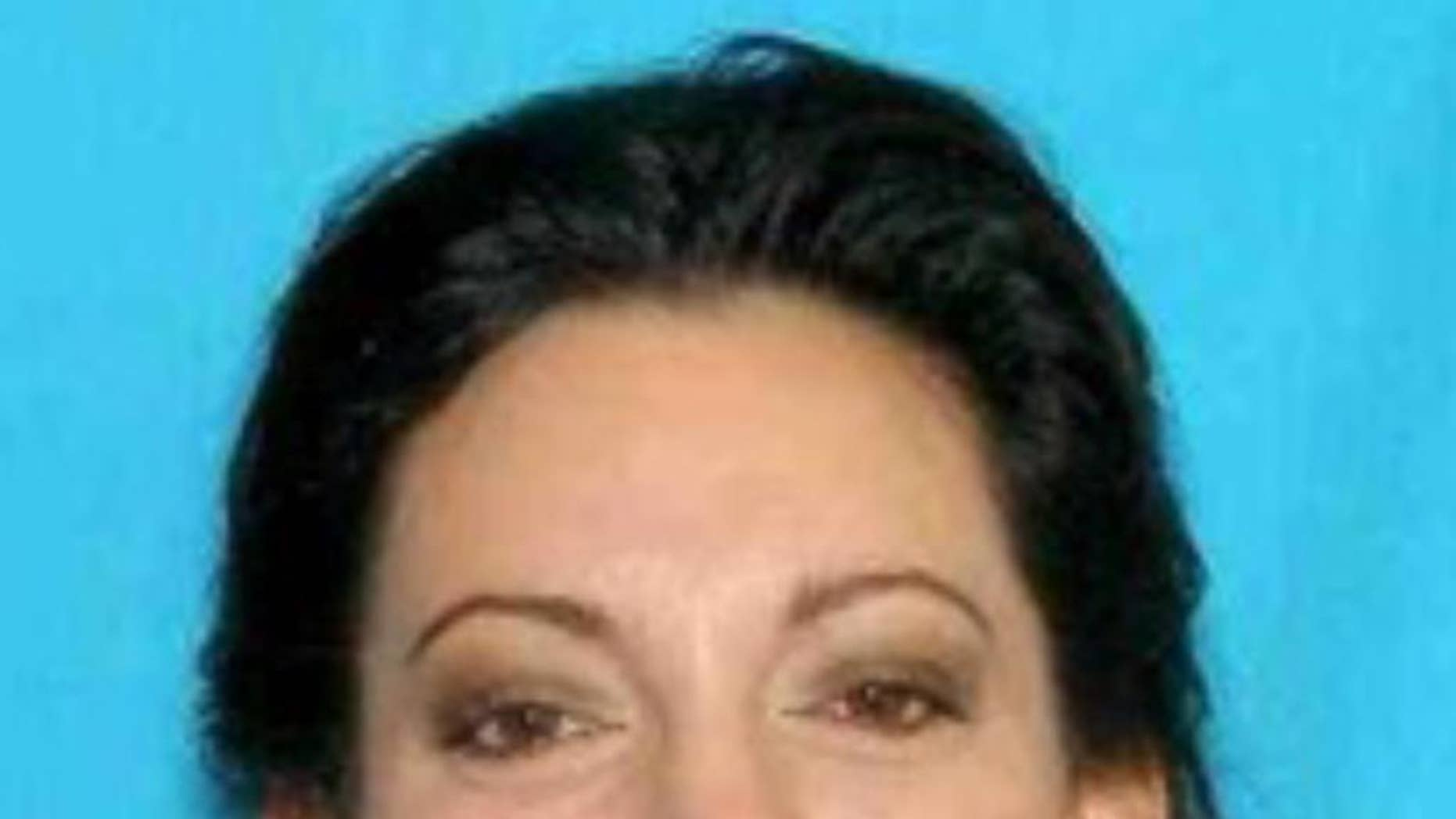 This image provided by Cannon Beach Wash. Police Department shows an undated photo of Jessica Smith, 40. A hotel housekeeper discovered an injured 13-year-old girl and the body of her 2-year-old sister at an inn on the Oregon Coast on Friday,Aug. 1, 2014 and police were searching for their mother. Cannon Beach Police Chief Jason Schermerhorn said Smith, 40, of Goldendale, Washington, is a person of interest in the case. (AP Photo/Cannon Beach Police Department)
