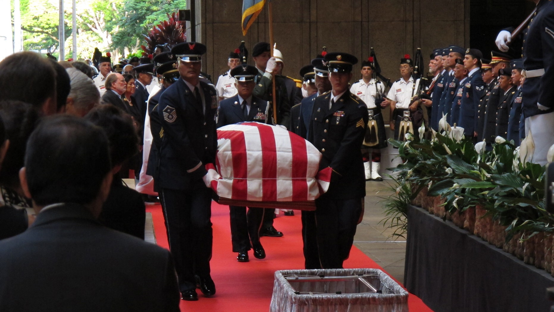 Saturday, Dec. 22, 2012: Pallbearers carry the casket of Sen. Daniel Inouye into the courtyard of the Hawaii state Capitol during a visitation ceremony in Honolulu.