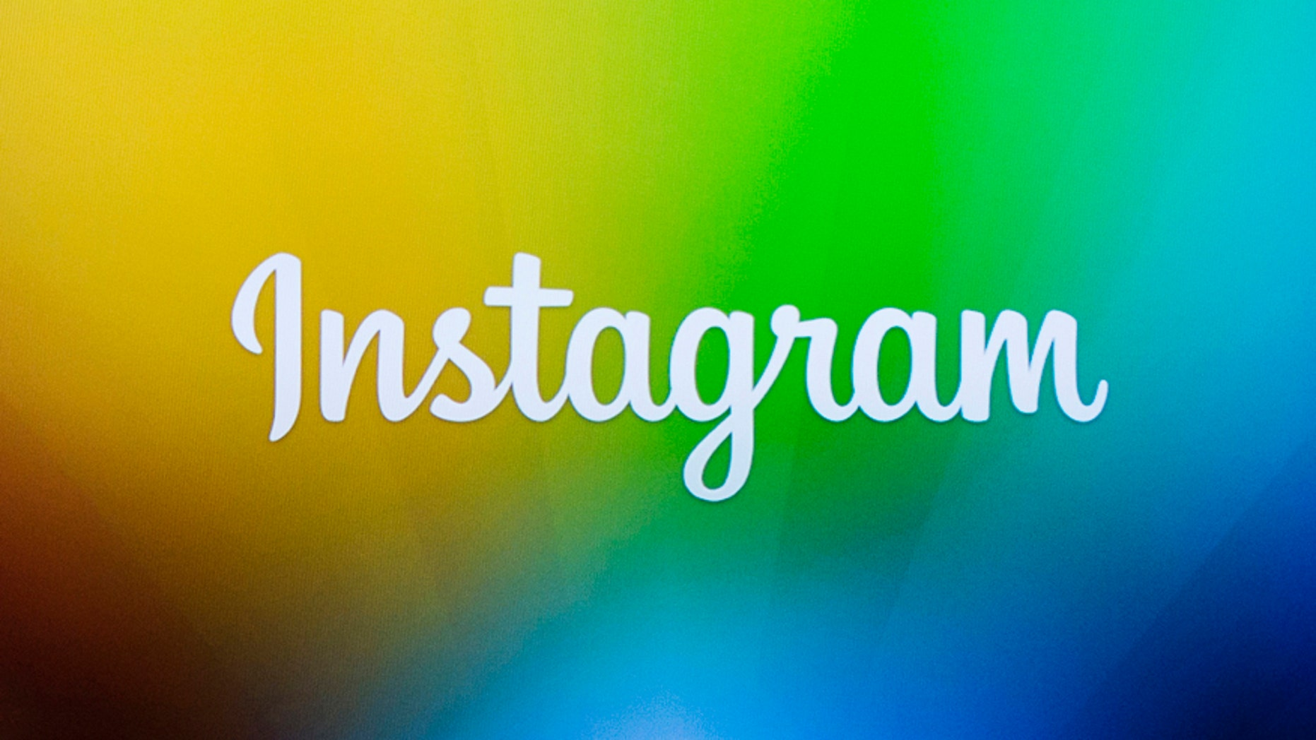 File photo - A screen displays the Instagram logo.