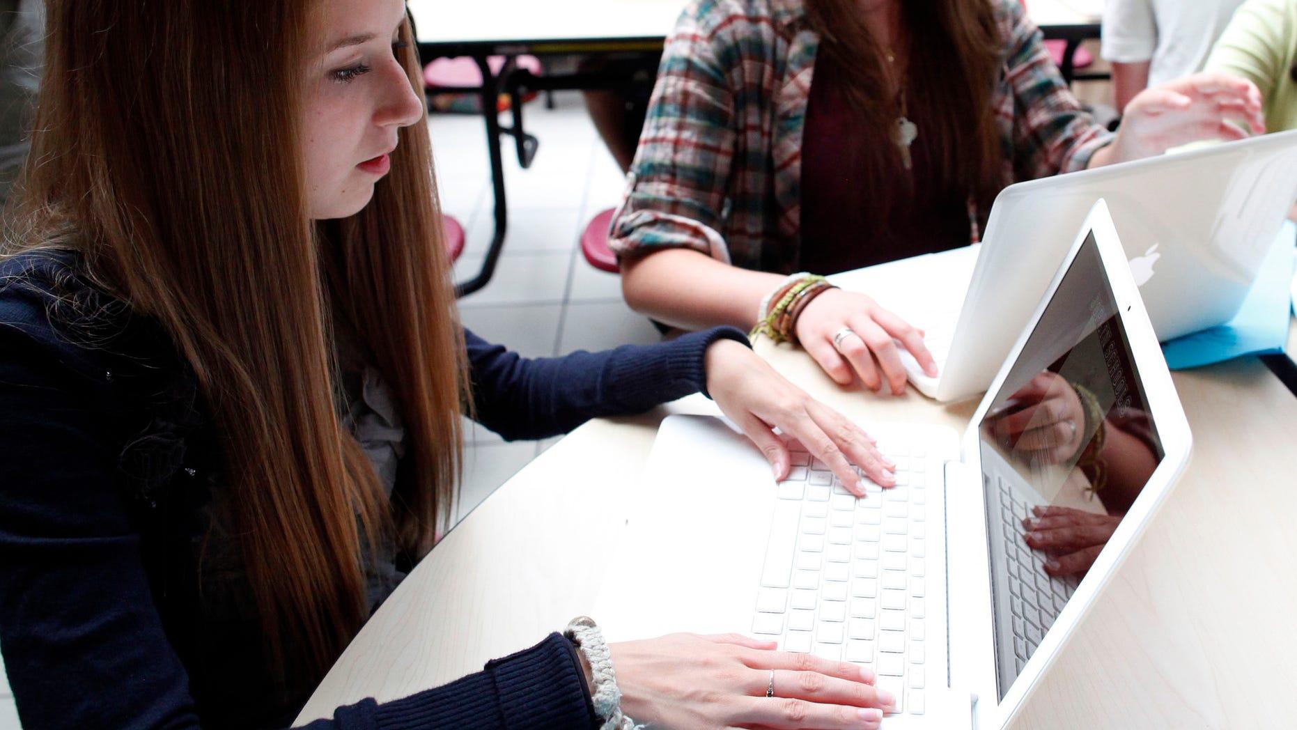 FILE: Aug. 17, 2011: Students with laptops at Joplin High School in Joplin, Missouri.