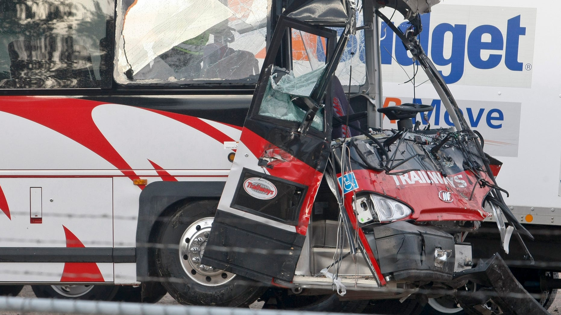 A Burlington Trailways bus is seen at the Kearney police lot in Kearney, Neb., Thursday, Oct. 6, 2011. Five people were treated at hospital after the Denver-bound bus rammed into an overturned semitrailer on Interstate 80 near Gibbon, Neb., early Thursday. The Nebraska State Patrol says 41 people were taken to a hospital in Kearney, where 30 people had been treated and released. Of the five admitted, one was in critical condition and one was in serious condition. The other passengers spent about two hours at an American Red Cross shelter until the bus operator could get another bus there.