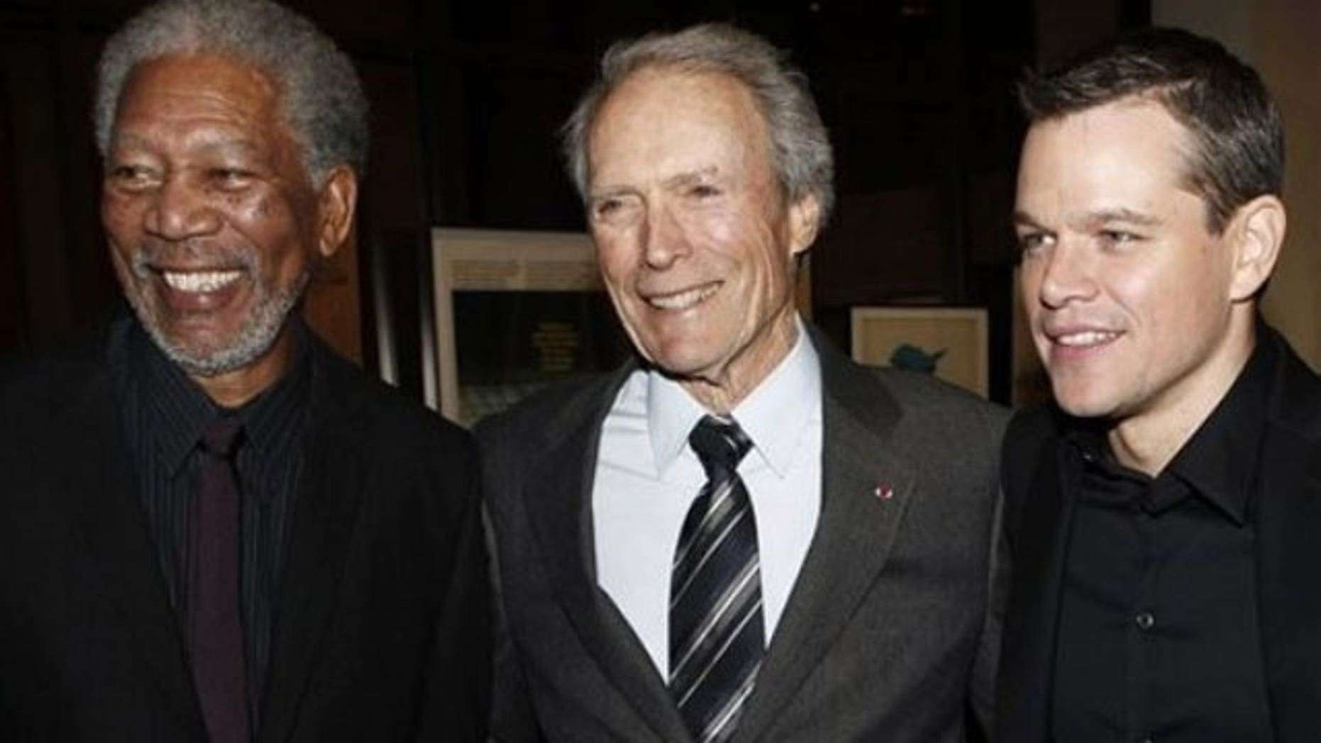 """Dec. 3: Director Clint Eastwood, center, and cast members Morgan Freeman, left, and Matt Damon pose together at the premiere of """"Invictus"""" in Beverly Hills, Calif."""