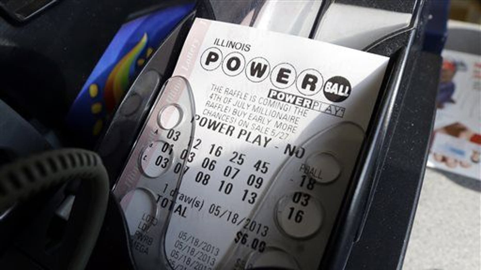 A Powerball lottery ticket is printed out of a lottery machine at a convenience store in Illinois.