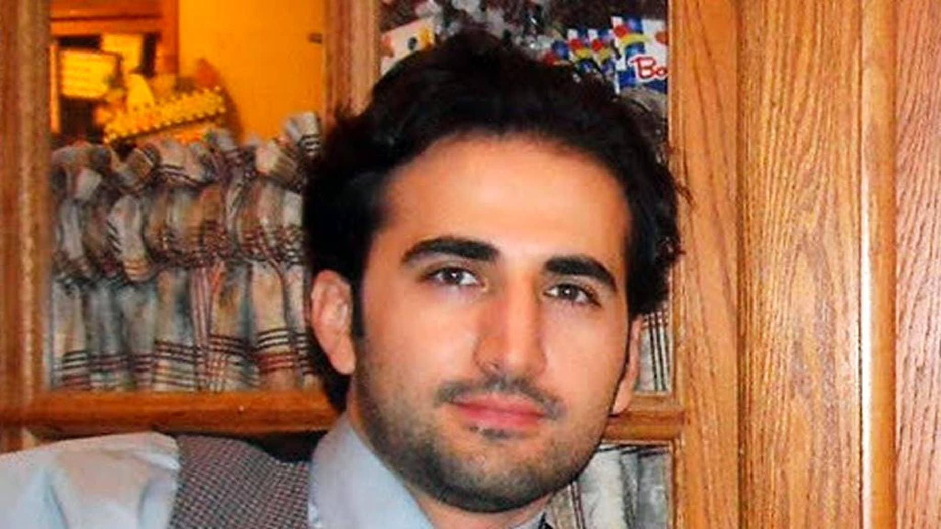 Amir Hekmati, a former U.S. Marine being held in Iran over the past two years was convicted of criminal charges after being accused of working for the CIA. (AP Photo/Hekmati family via FreeAmir.org, File)
