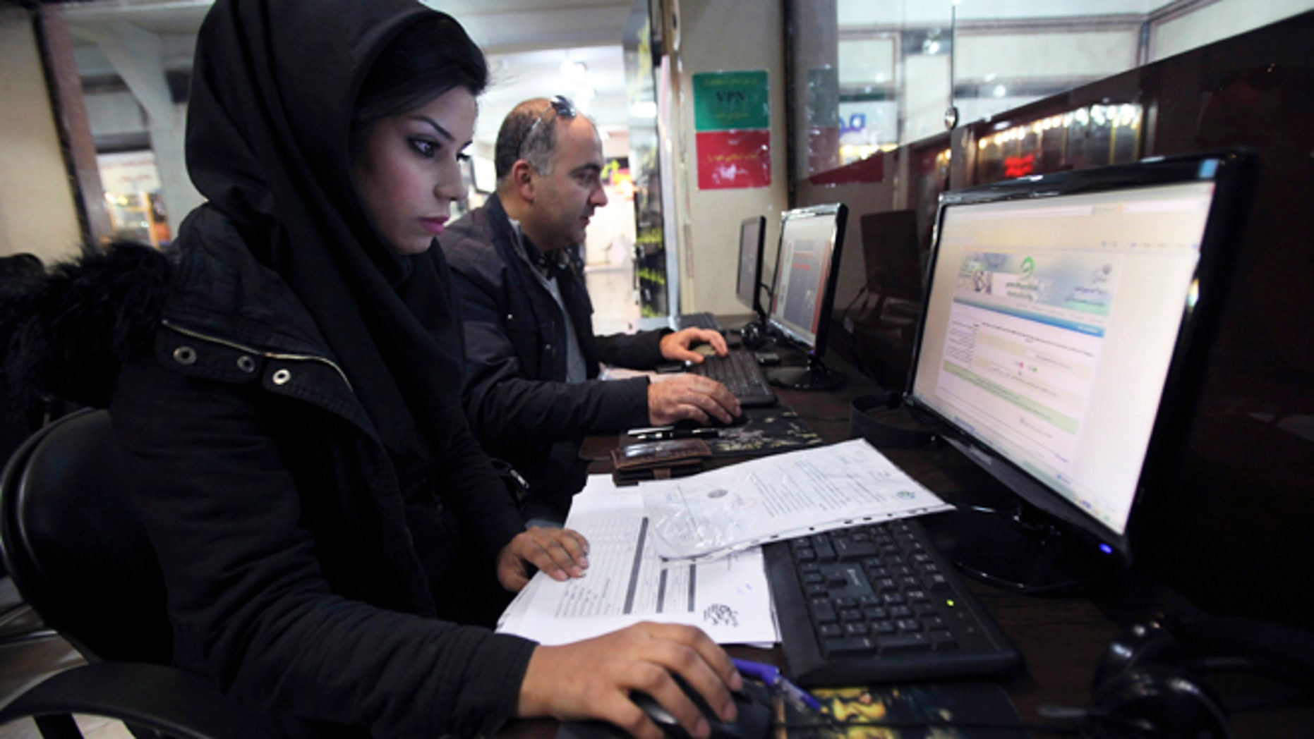 Jan. 6, 2013: Iranians surf the web in an internet cafe at a shopping center, in central Tehran, Iran. Iran's police chief says the Islamic Republic is developing new software to control social networking sites.