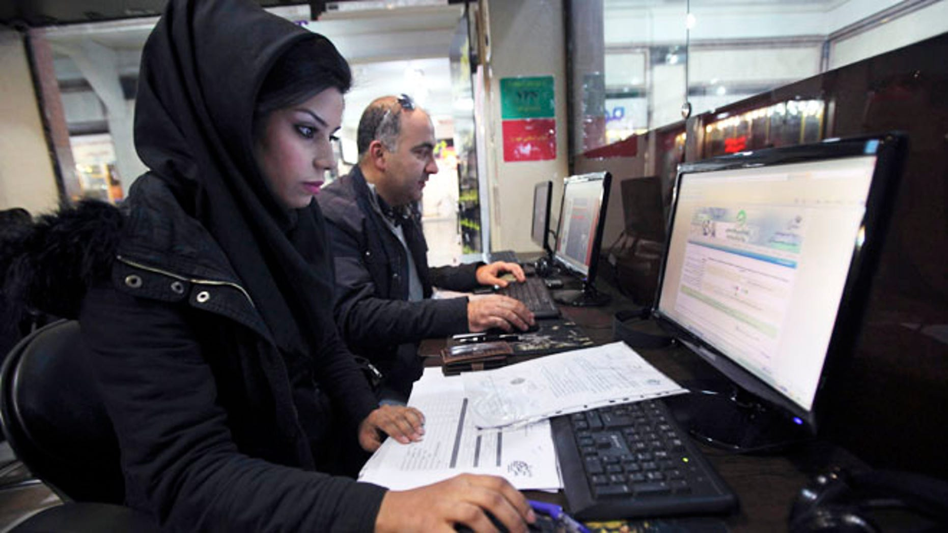 Jan. 6, 2013: Iranians surf the web in an internet cafe at a shopping center, in central Tehran. Iranian authorities have blocked many foreign-based virtual private networks, or VPNs, severely restricting access to many websites.