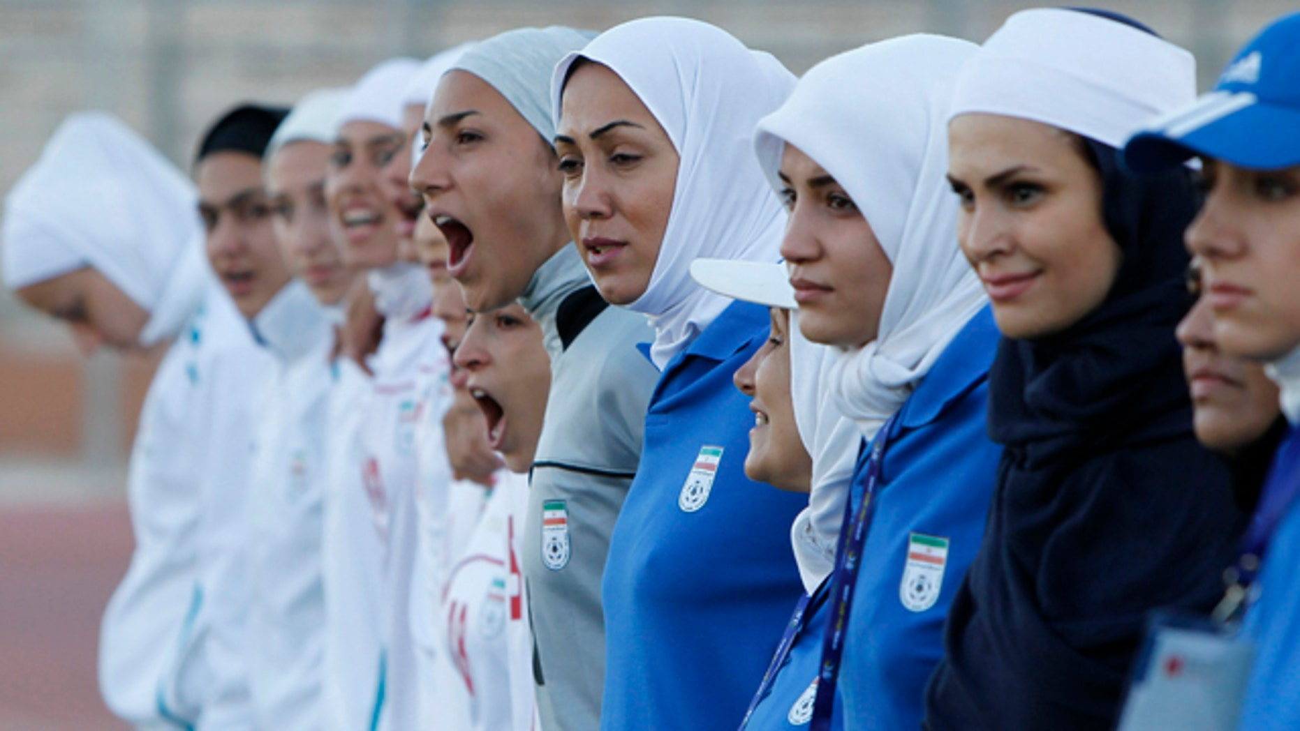 The Iranian women's national soccer team lines up before its qualifying match against Jordan for the 2012 London Olympic Games in Amman, June 3, 2011. The Iranian team was banned from the match on Friday in the second round of qualifiers in protest against guidelines on its headscarves.